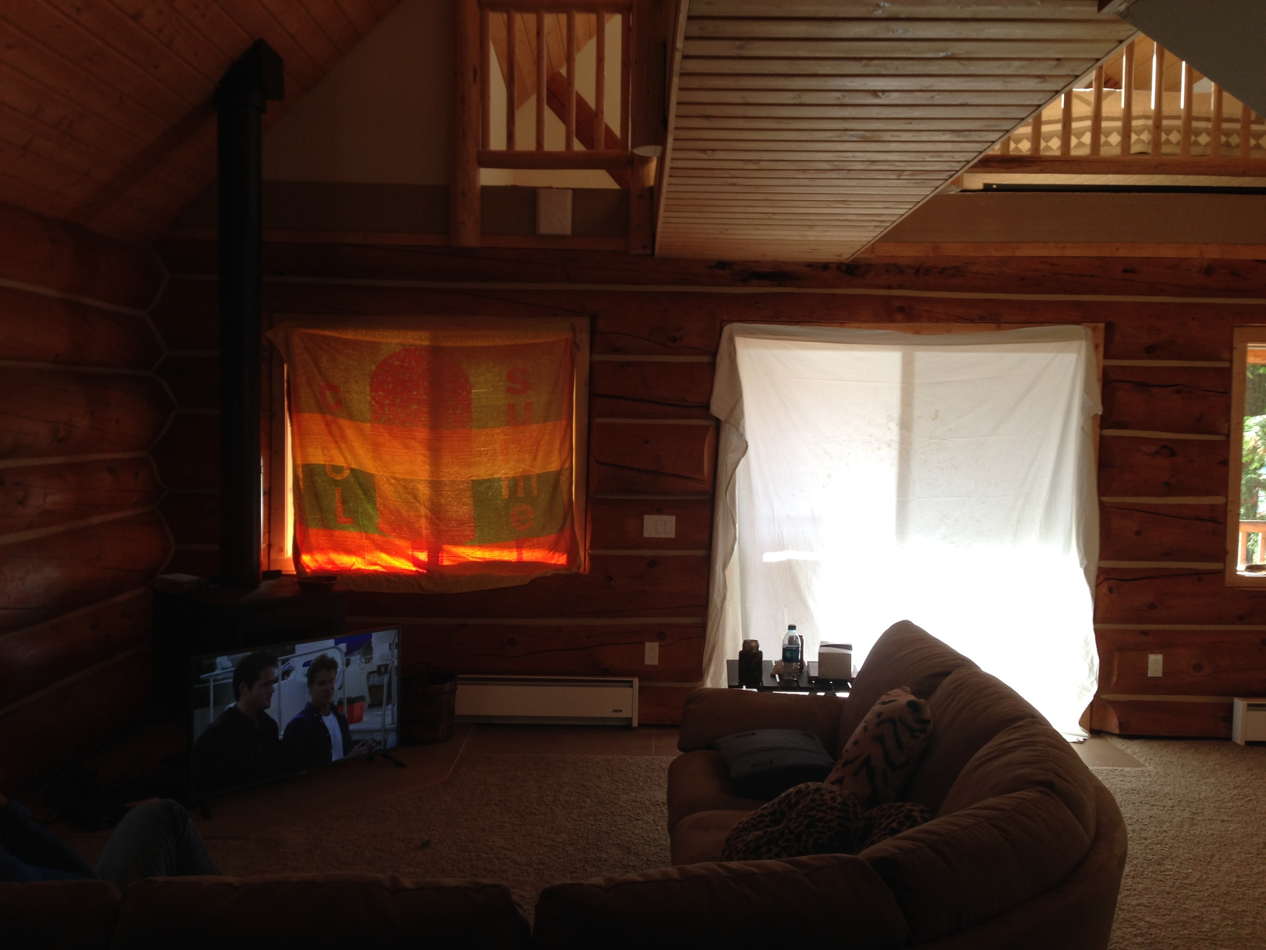 The sun comes in so bright in the evenings that we can't see the TV. Ordering some window coverings, but for now a sheet and beach towel will work. #Redneck