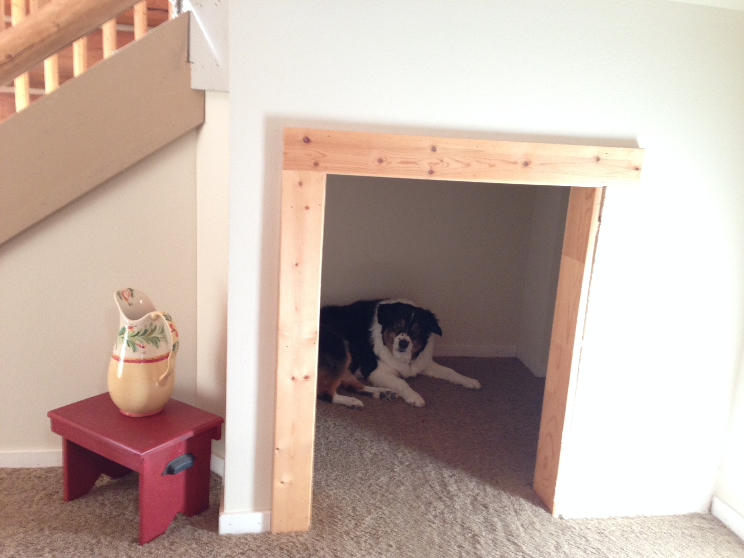 Fiona in her Harry Potter style cupboard under the stairs room. Her big bed goes between there and the back porch.