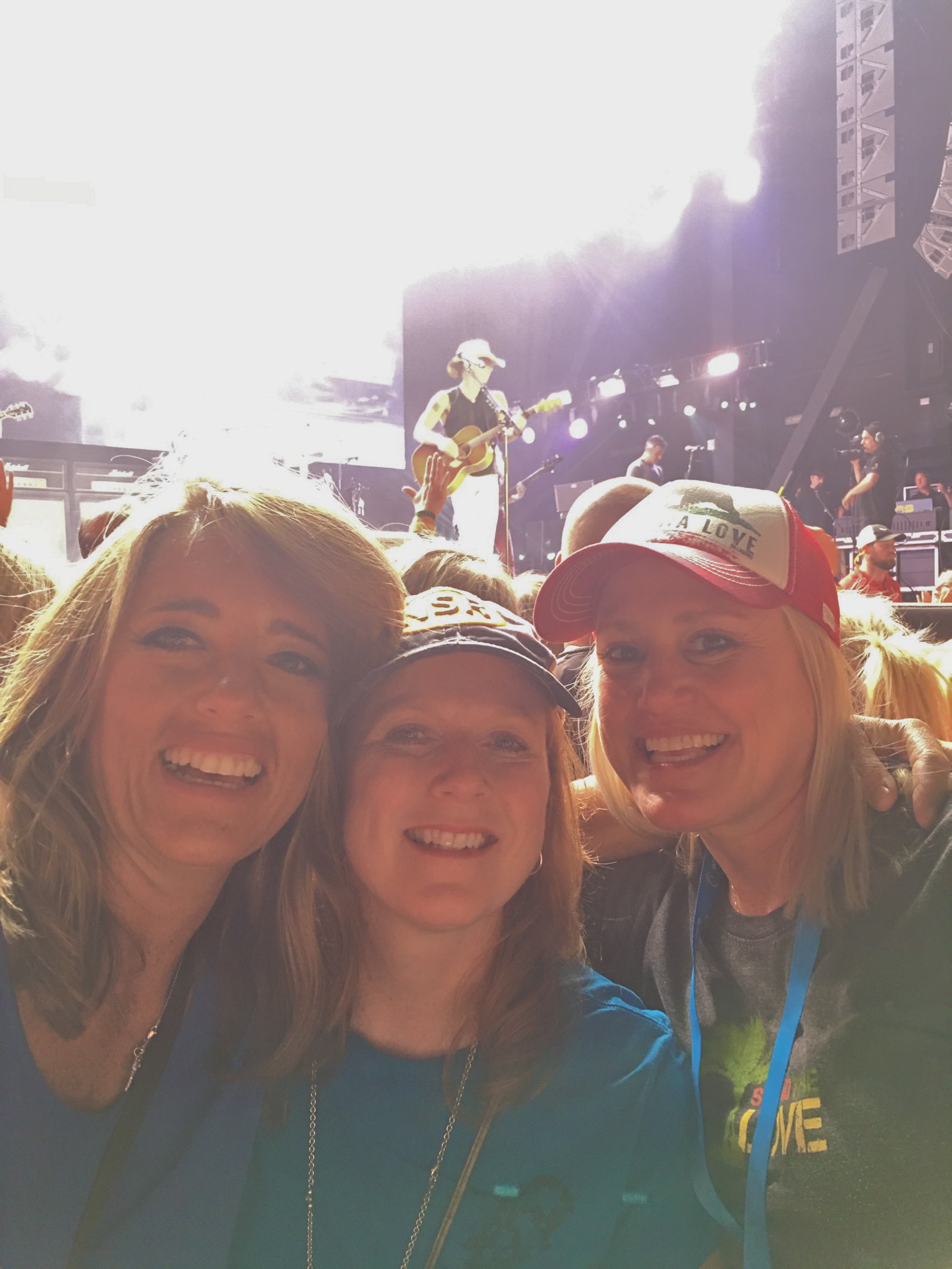 Connie, Michelle, and me with Kenny on stage behind us. www.Welcometothesandbar.com is there website.