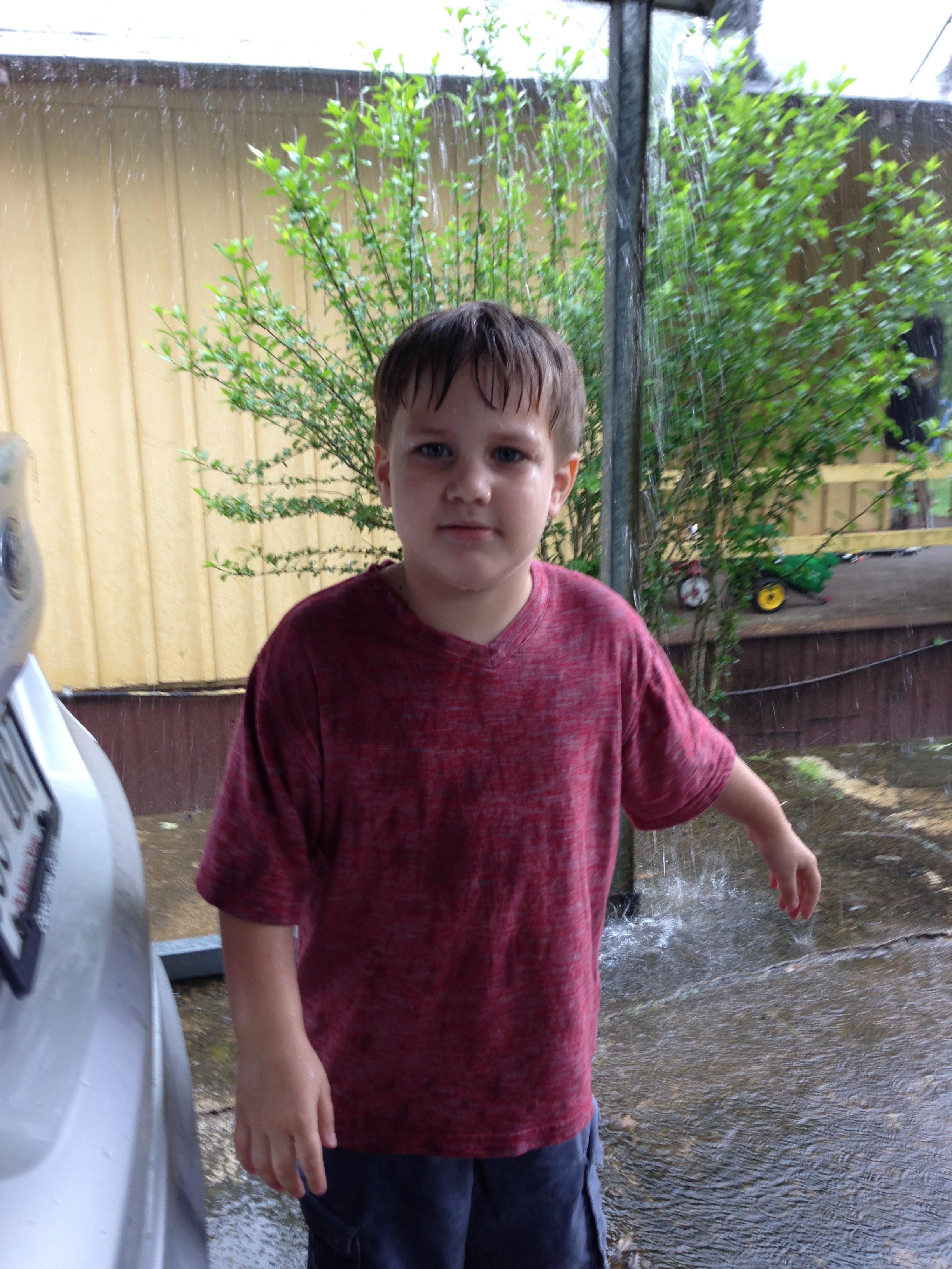 My cousin Michael's grandson, Bentley got a little wet in the downpour!