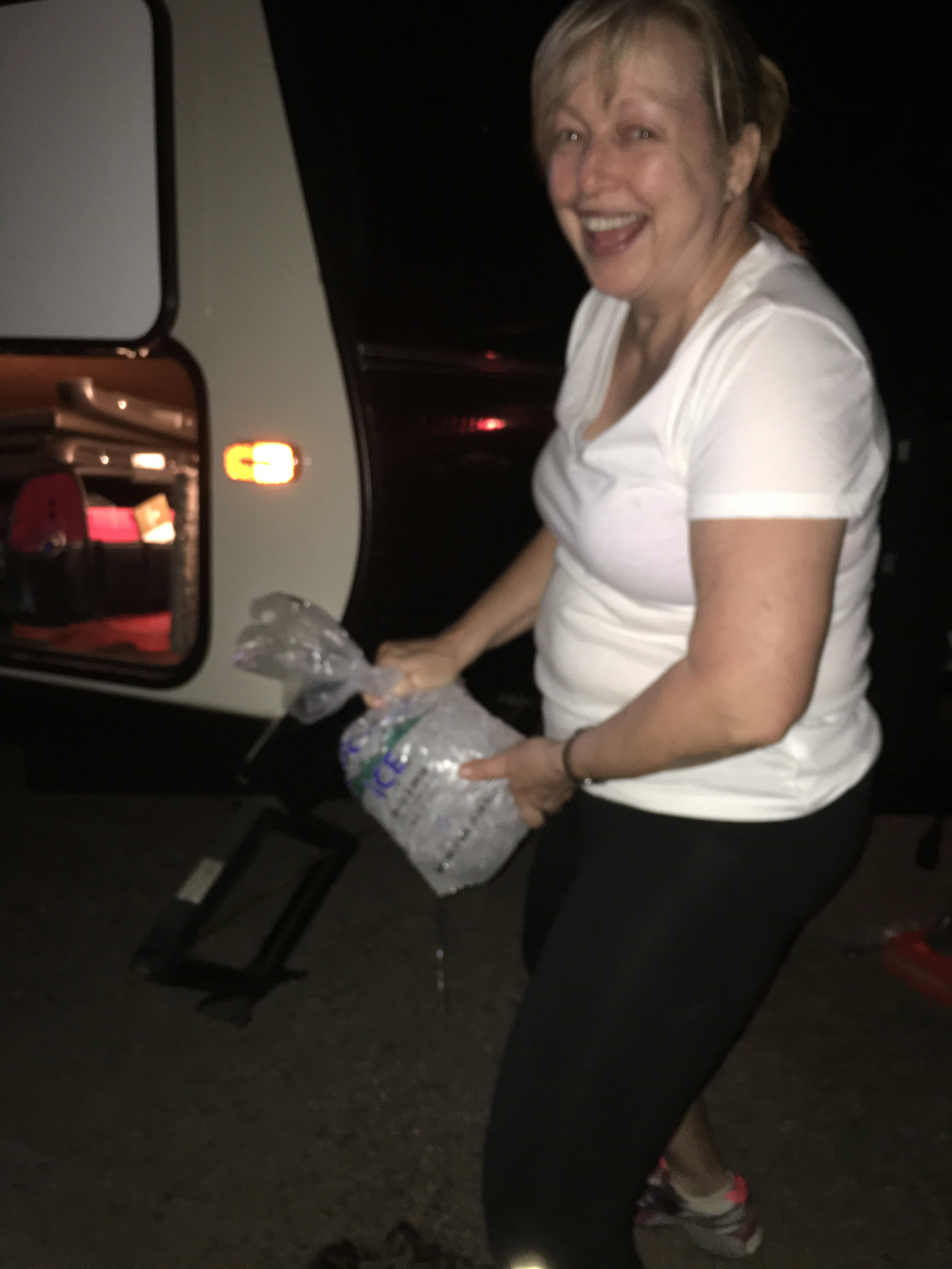 My sister, Penny draining a bag of ice and pretending she can pee standing up!