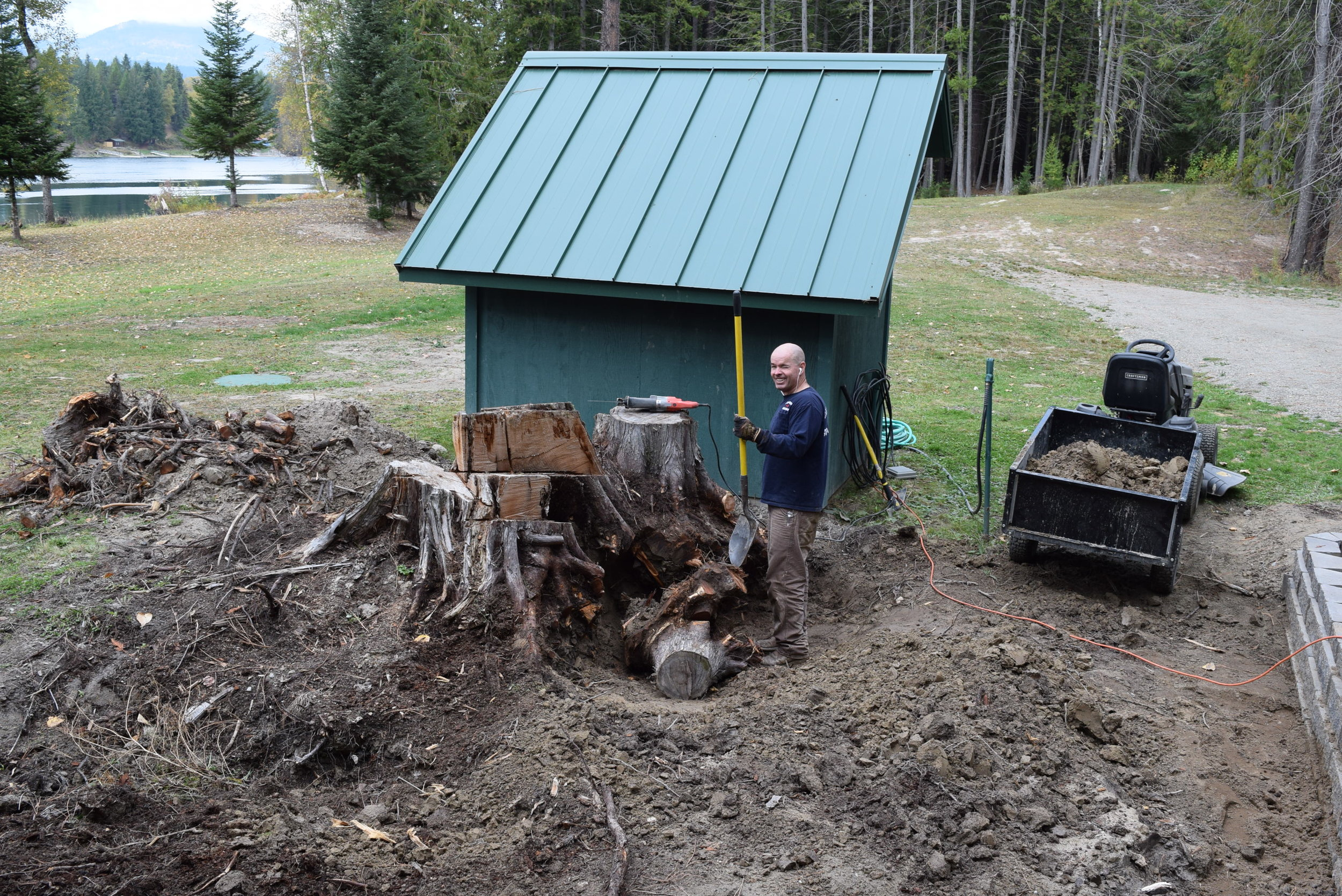 Paul digging out tree stumps by hand.