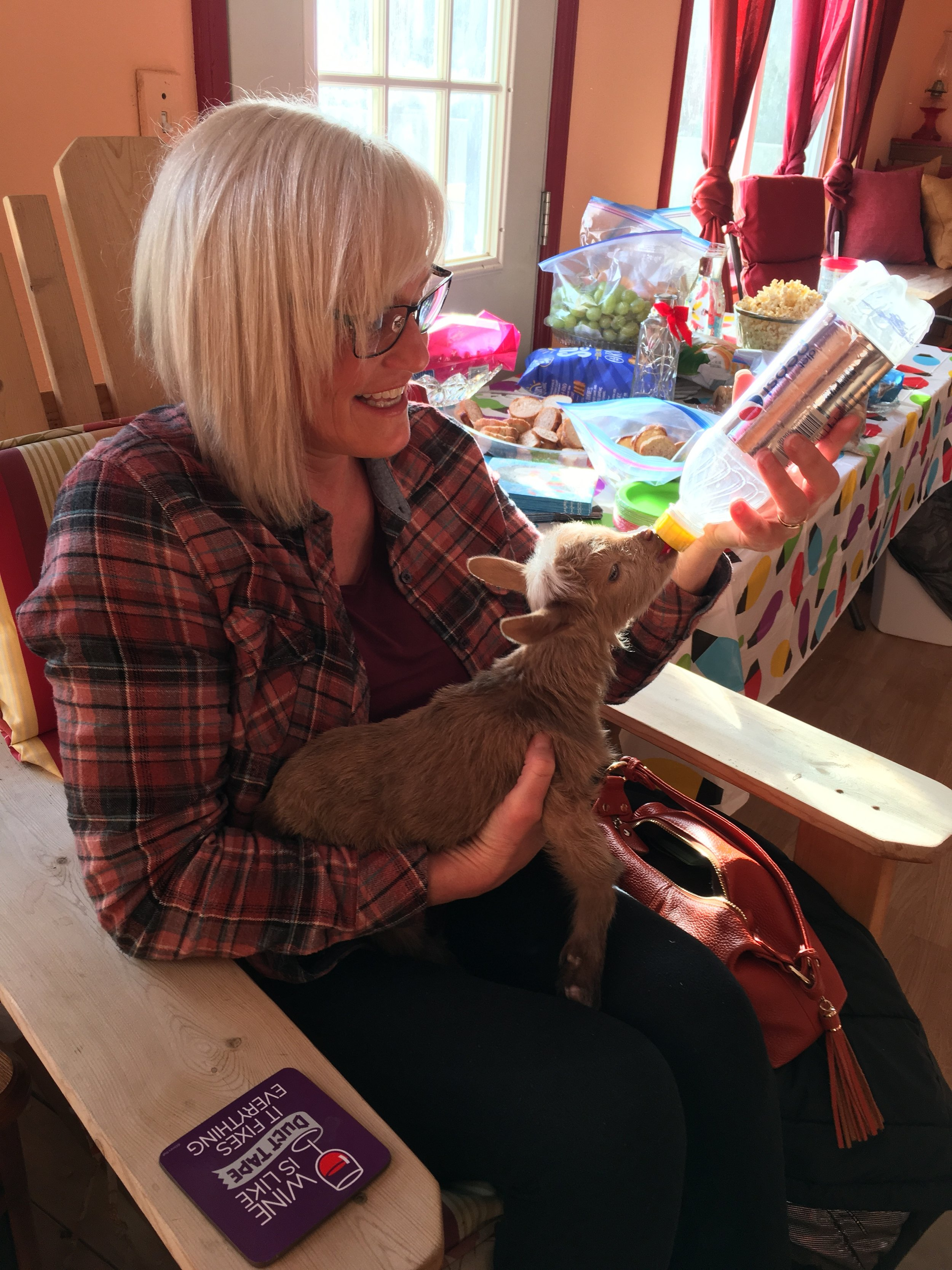 I got to feed an orphaned baby goat at my friends, Shannon's homemade wine tasting party.
