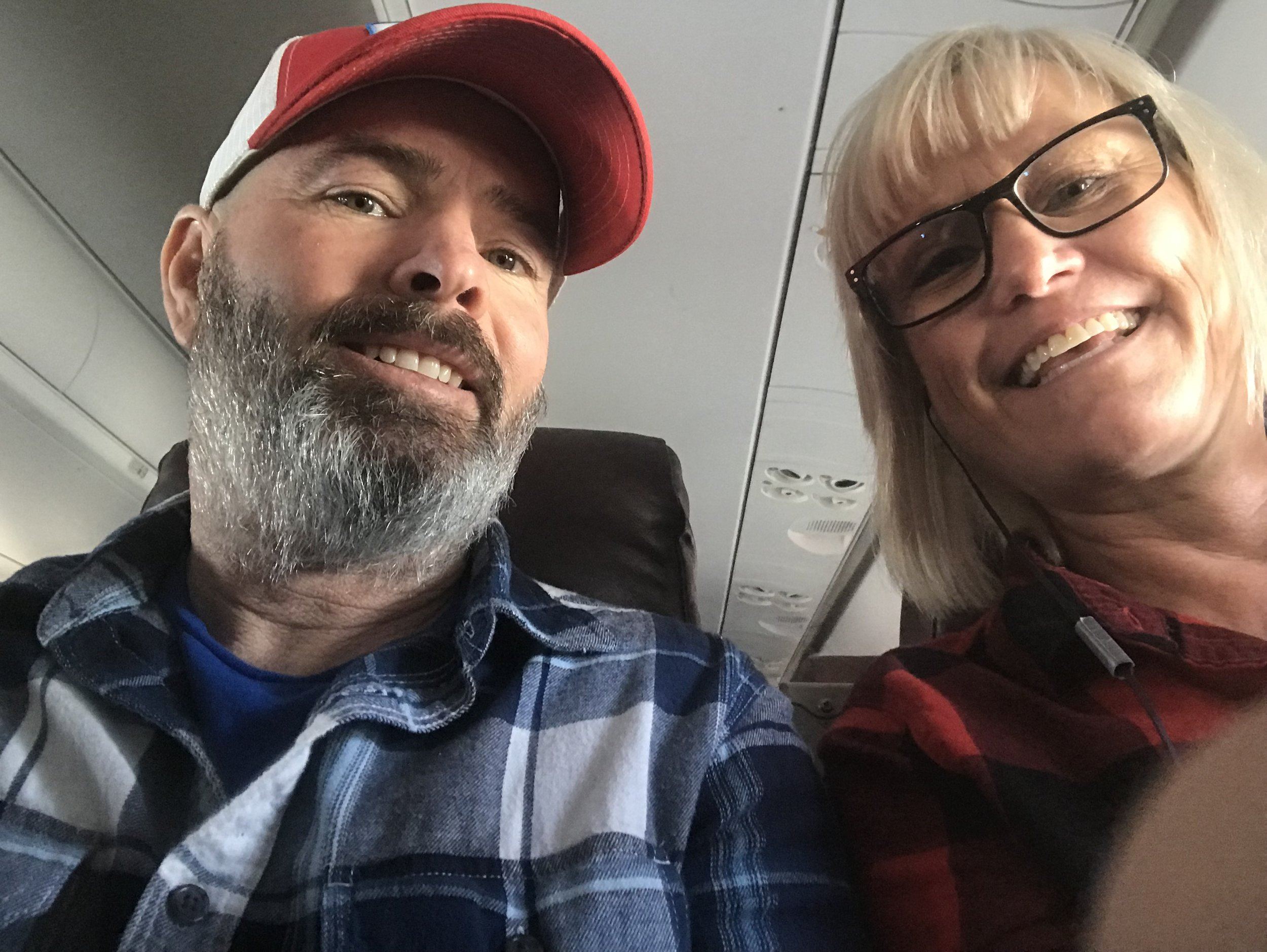 Paul traveling incognito with a beard. Hoping that HS would finally leave him alone while flying. The first leg of our long journey. And, yes that is duct tape on my earbuds. You can take the girl out of the country…