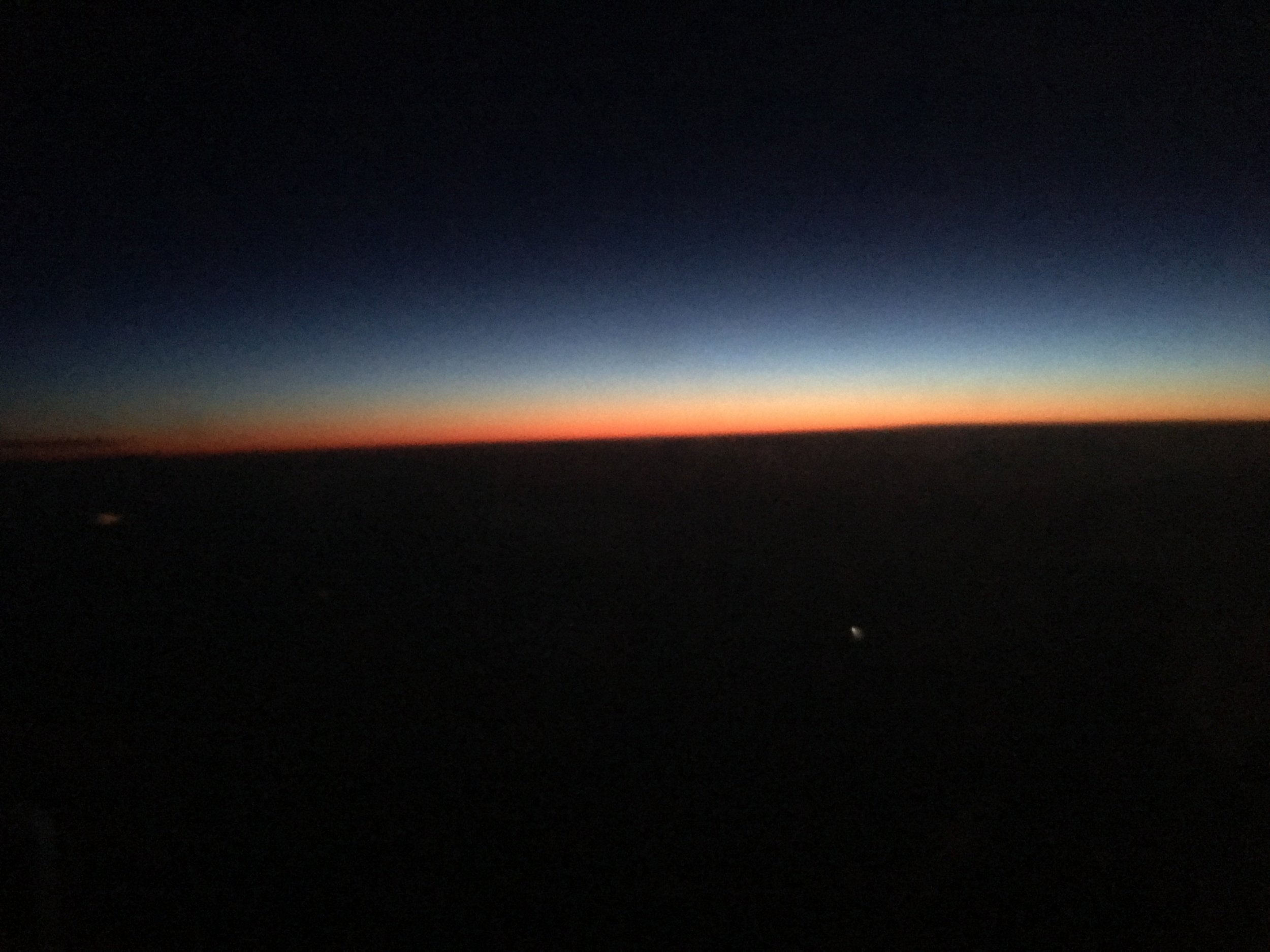 Now that's what I call a sunrise! The sun peaking up from the horizon as we flew from Iceland to Scotland.
