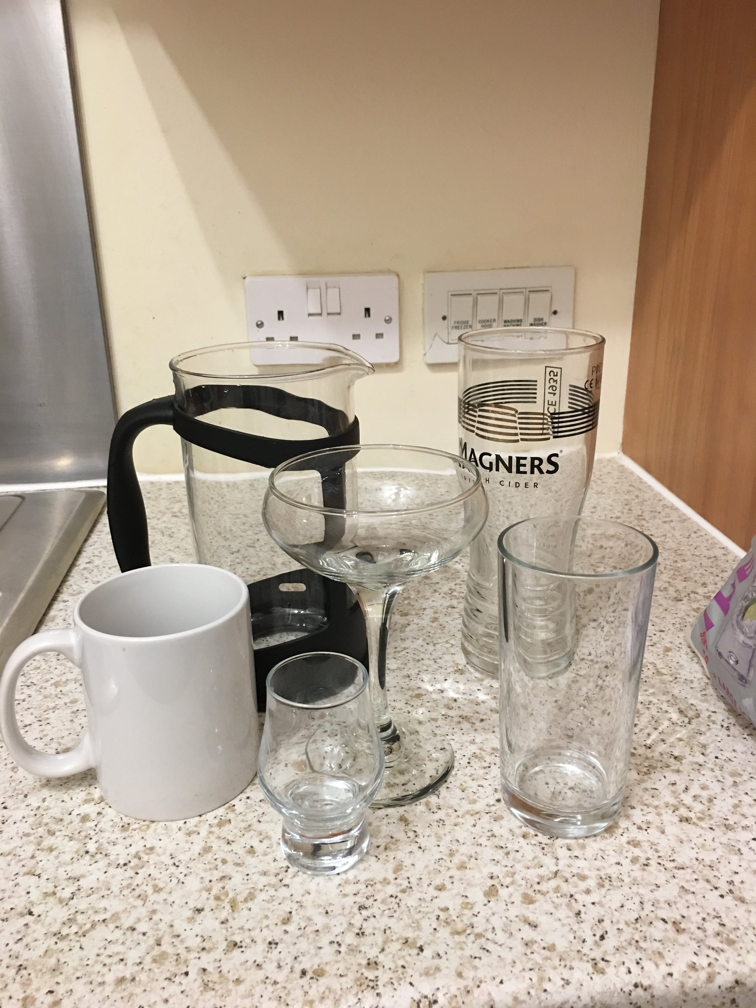 The random assortment of glasses available.