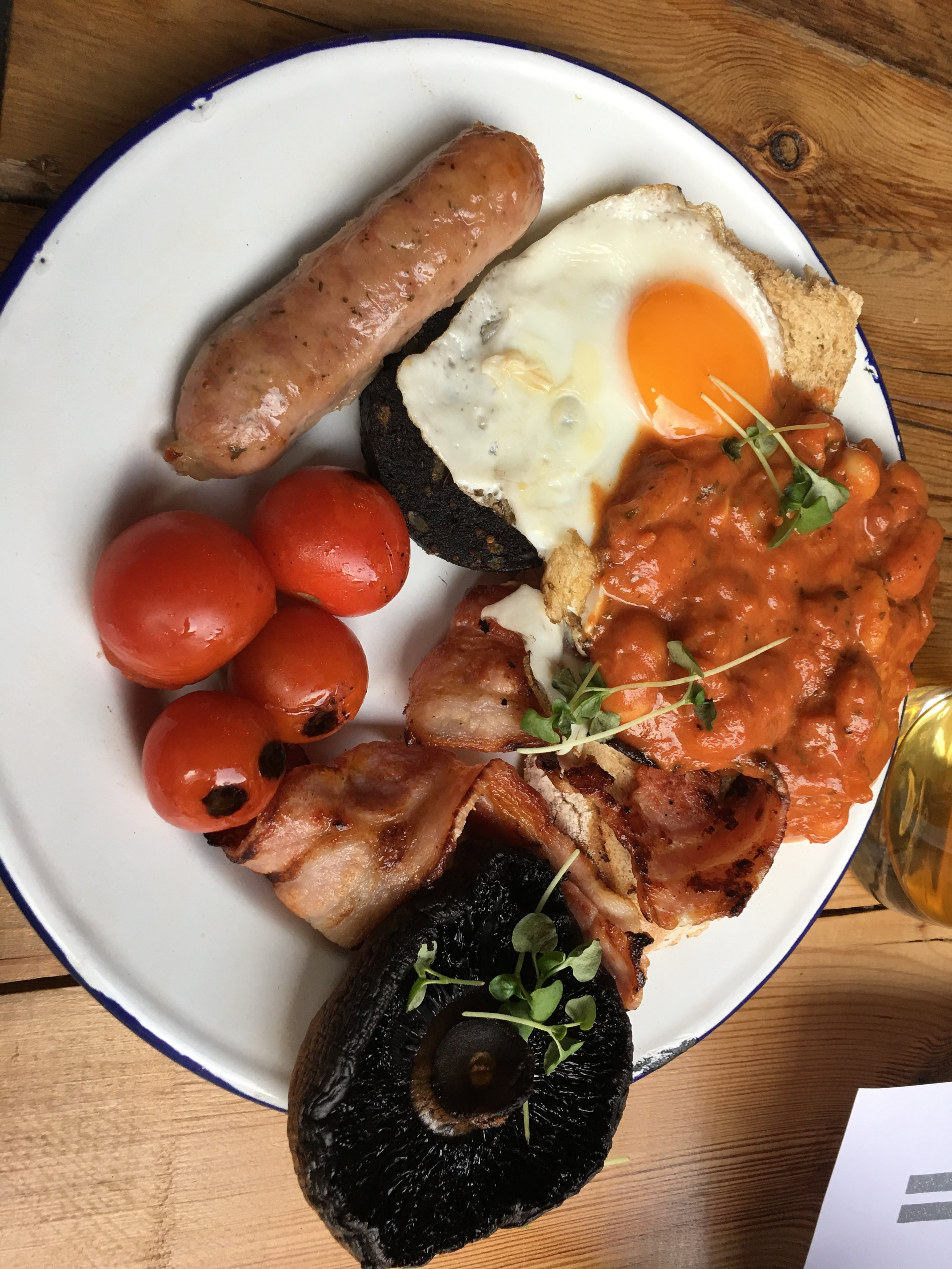 Weird sausage, egg, blistered tomatoes, black pudding (ie. blood sausage), stringy bacon, roasted mushroom, and spicy beans sitting on my toast! I had to try their version of breakfast to say I did. Wasn't all that bad.