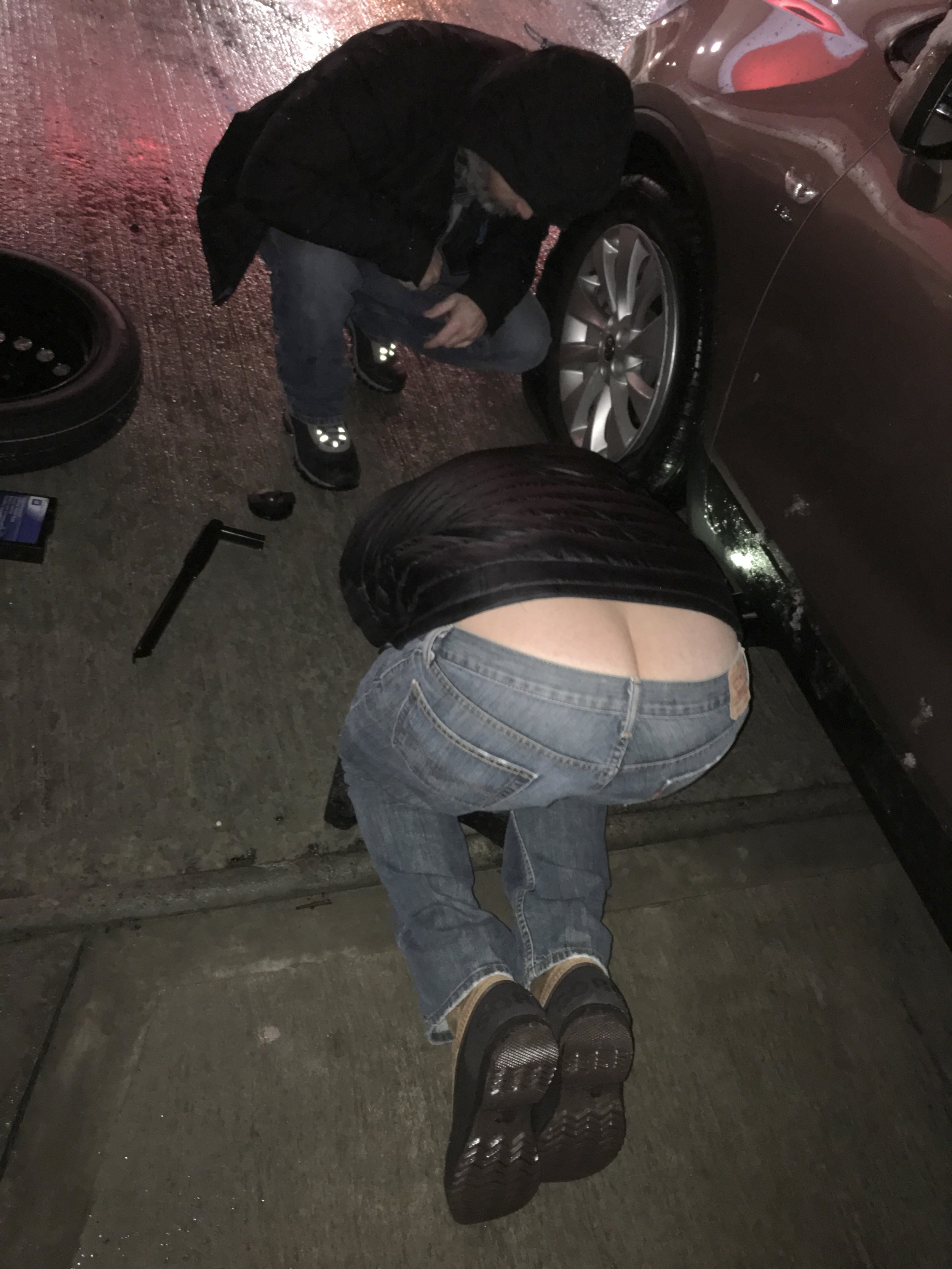 Paul and Mike changing the tire. Besides his apparent plumbing skills, Mike has some mechanic abilities.