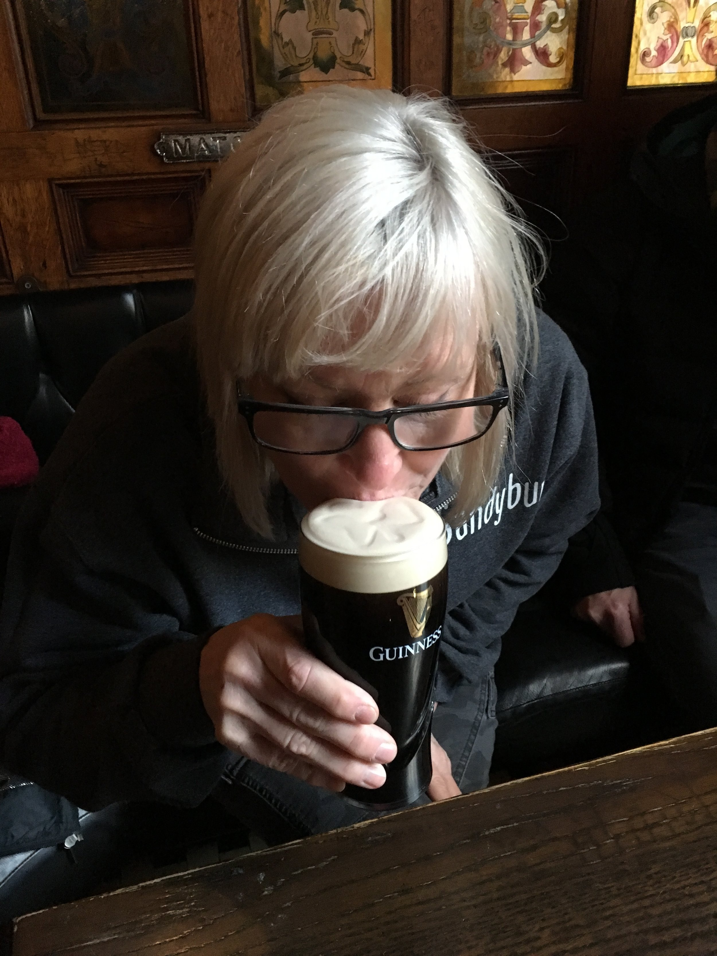 """A proper pint at the Crown Bar in Belfast. I learned to not order a """"black and tan"""" in Northern Ireland unless you want to get yelled at by the bartender to go """" google that term! We don't serve that here!"""" I guess ordering an Irish Car Bomb might have gotten me kicked out altogether!"""