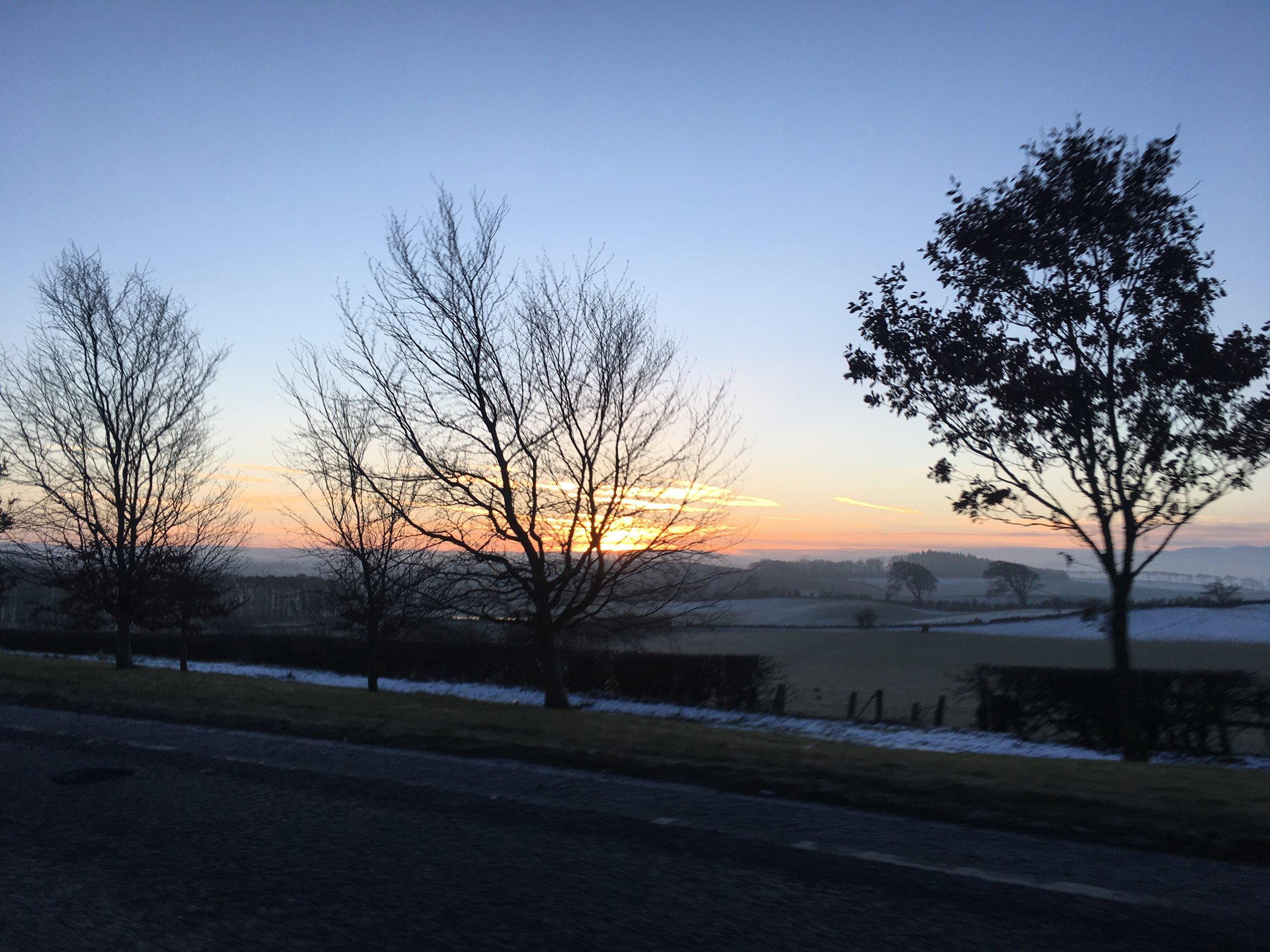 Scotland sunrise on the train ride to Edinburg.