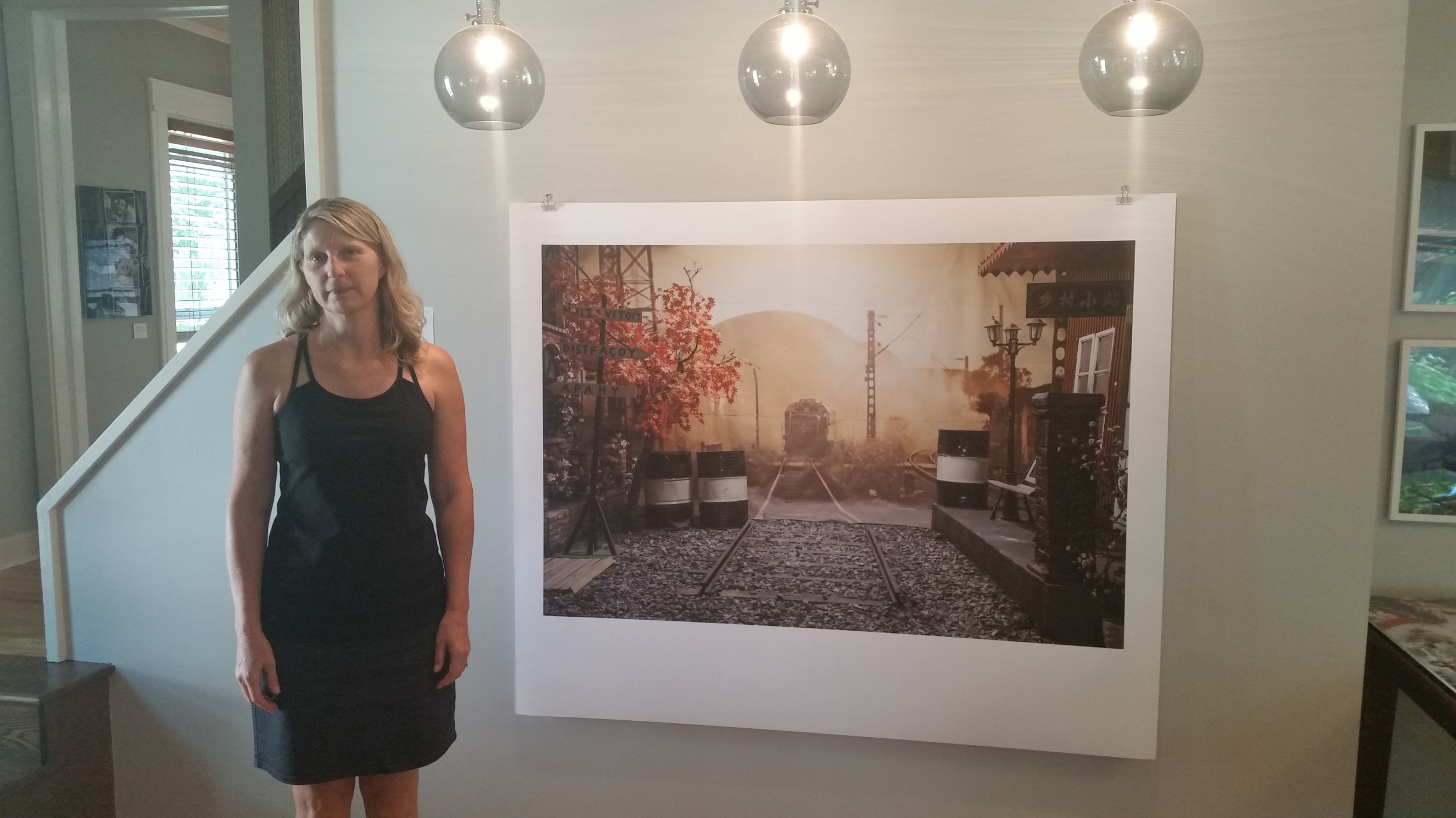 Priscilla Briggs next to one of her photos