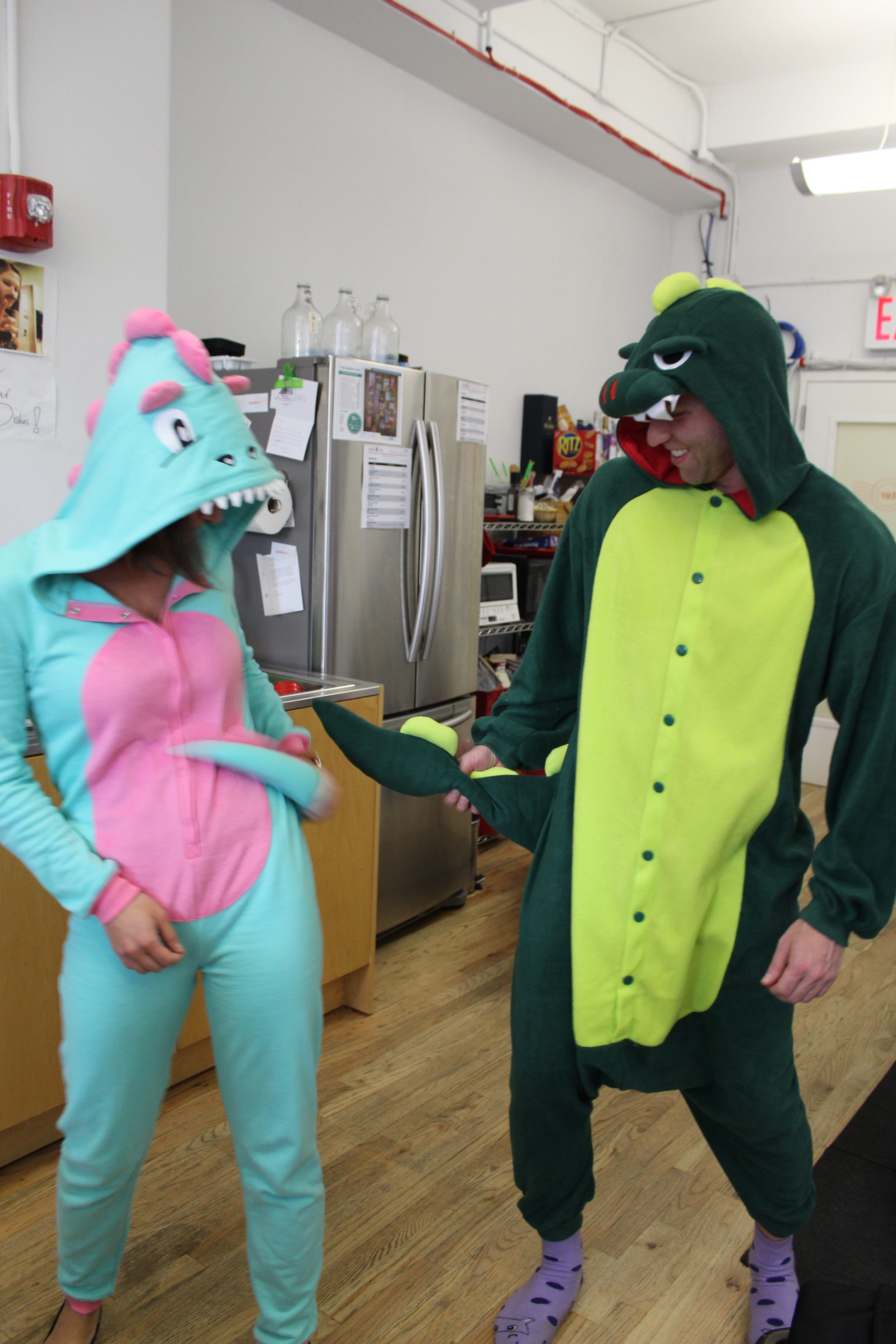 Brittany the dinosaur and Ryan the alligator in battle.