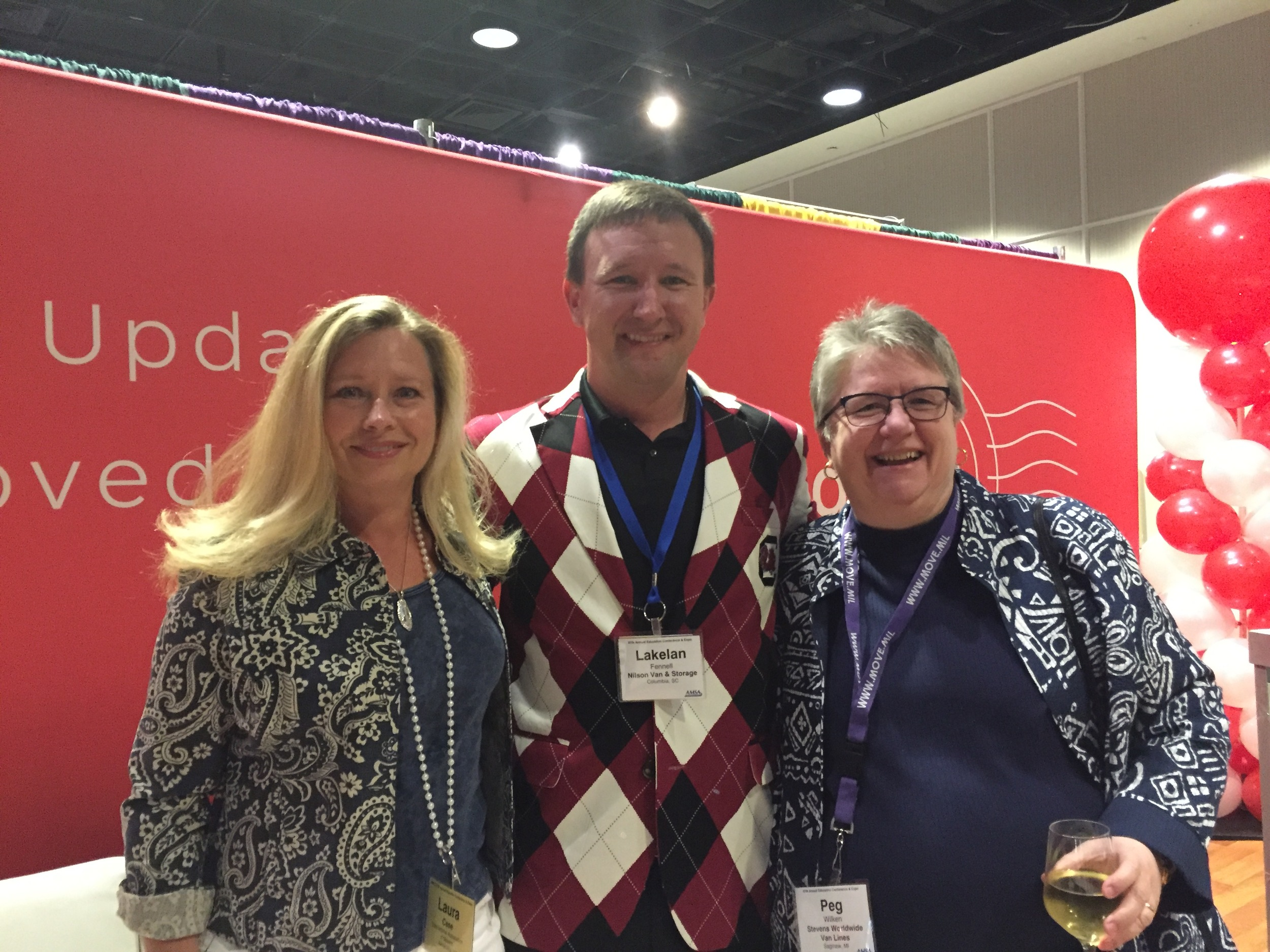 IAM, Nilson Van & Storage, and Stevens Worldwide visiting the Updater booth!
