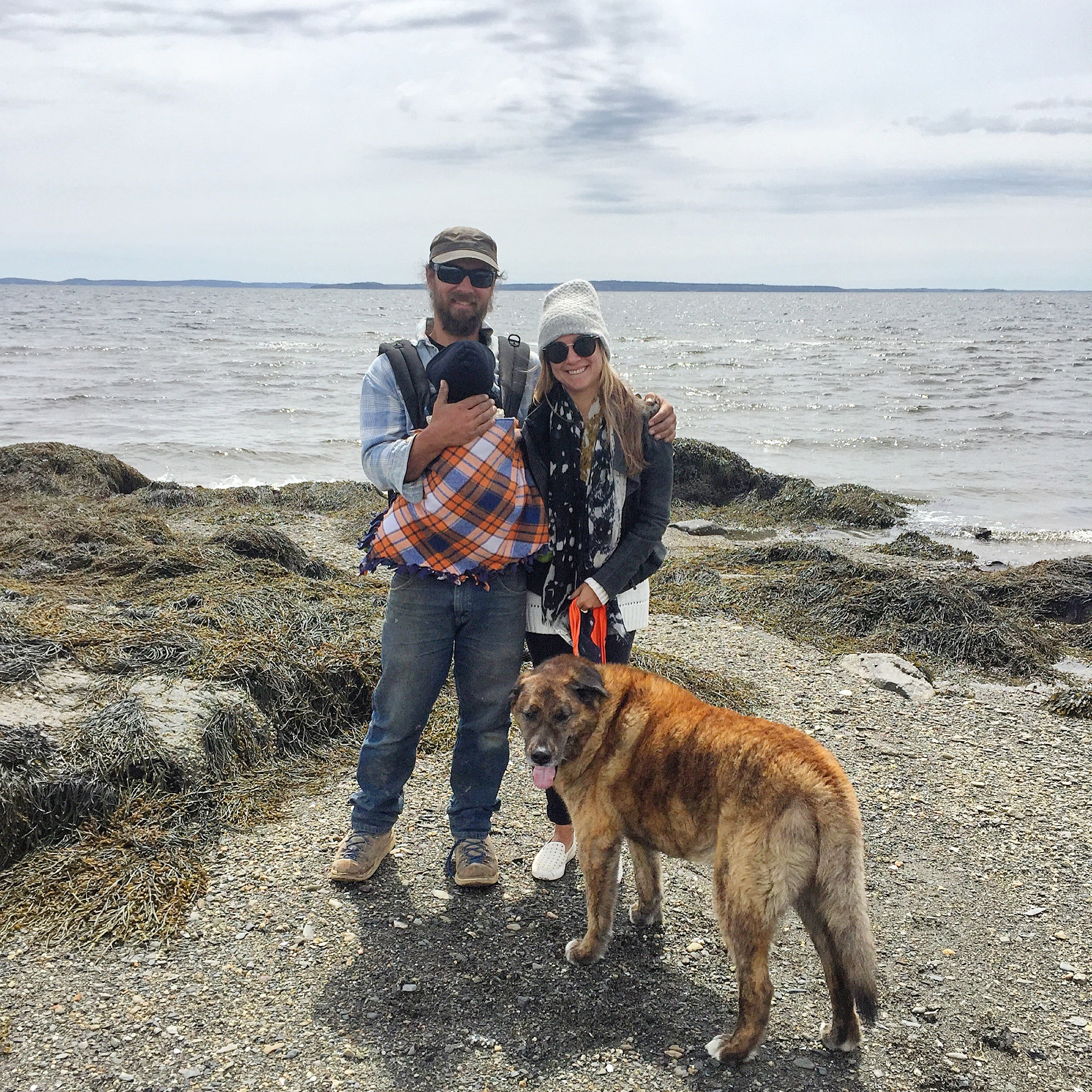 Getting outdoorsy with her brother, nephew, and their dog.