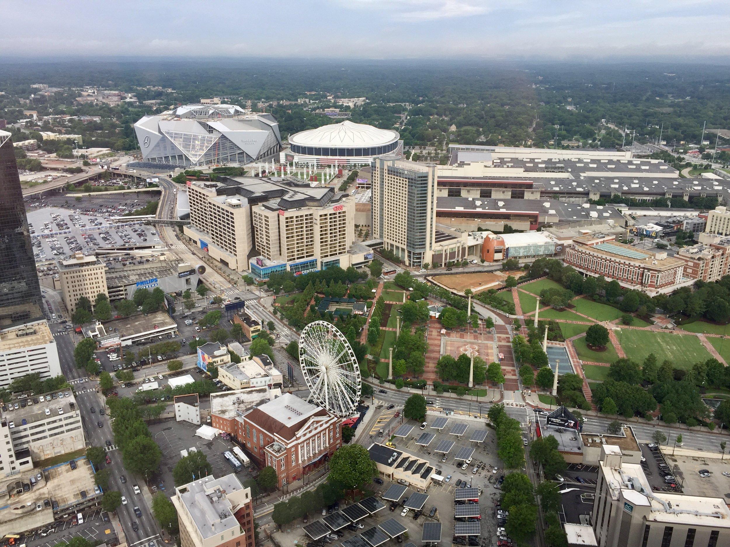 Bird's eye view of Atlanta, including Centennial Olympic Park, the Georgia Dome, the new Mercedes-Benz Stadium, and of course, the Georgia World Congress Center.