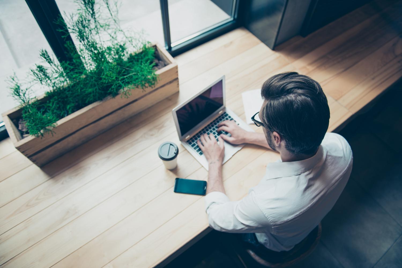 man on computer - how practical empathy breeds superb real estate customer service