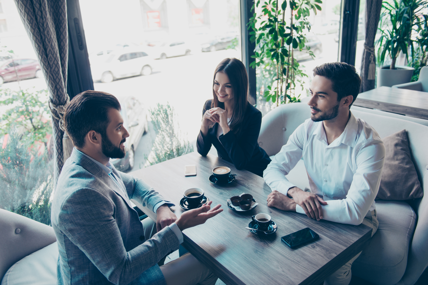 man speaks to couple - how practical empathy breeds superb real estate customer service