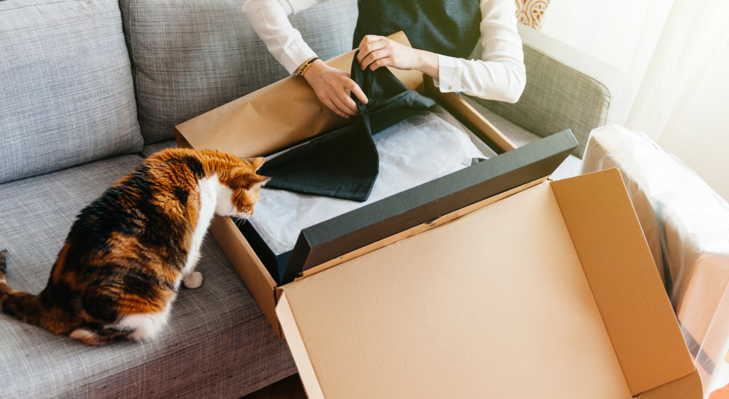 woman and cat with package - property management tech trends 2018