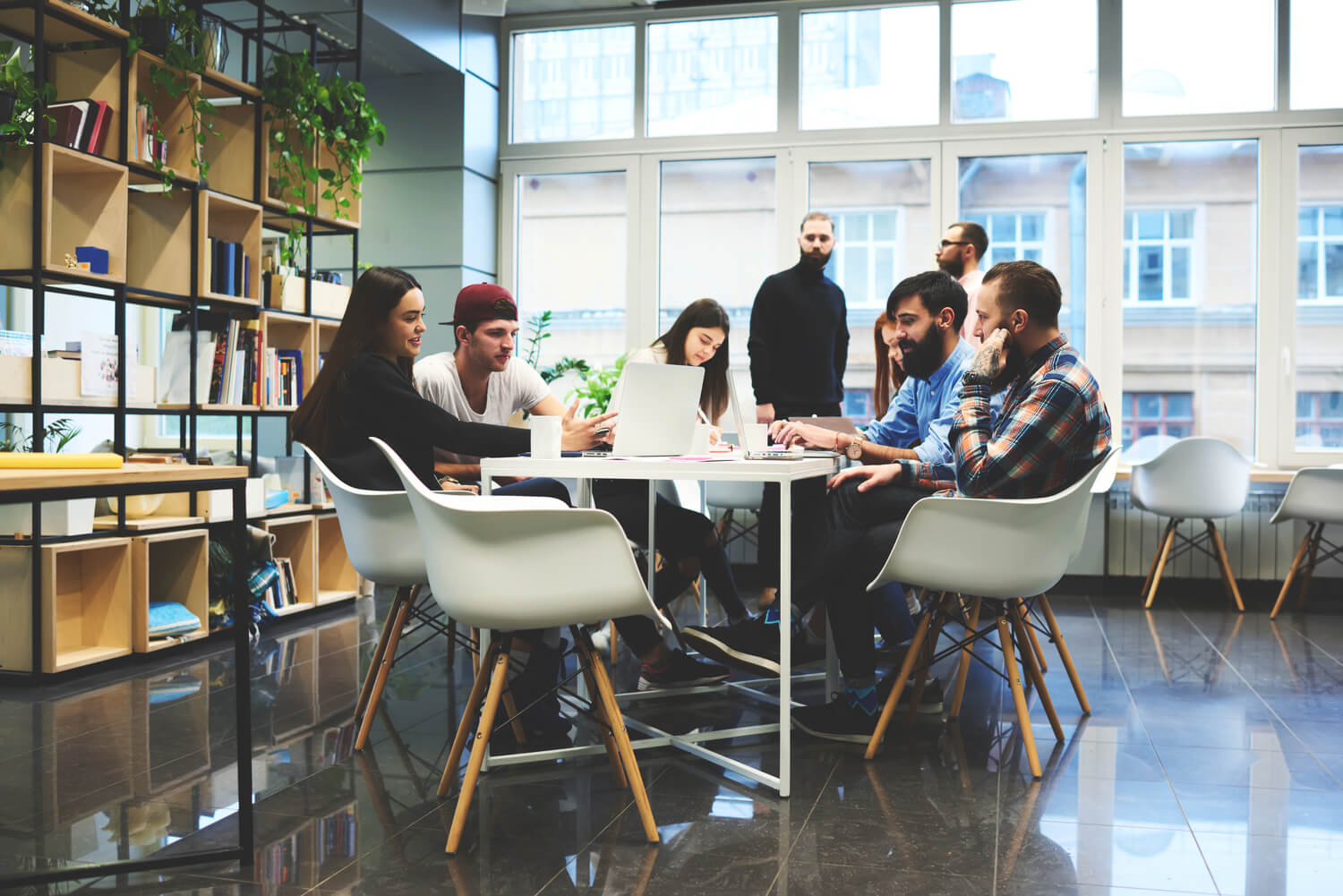 friends working table - coworking spaces residents will love
