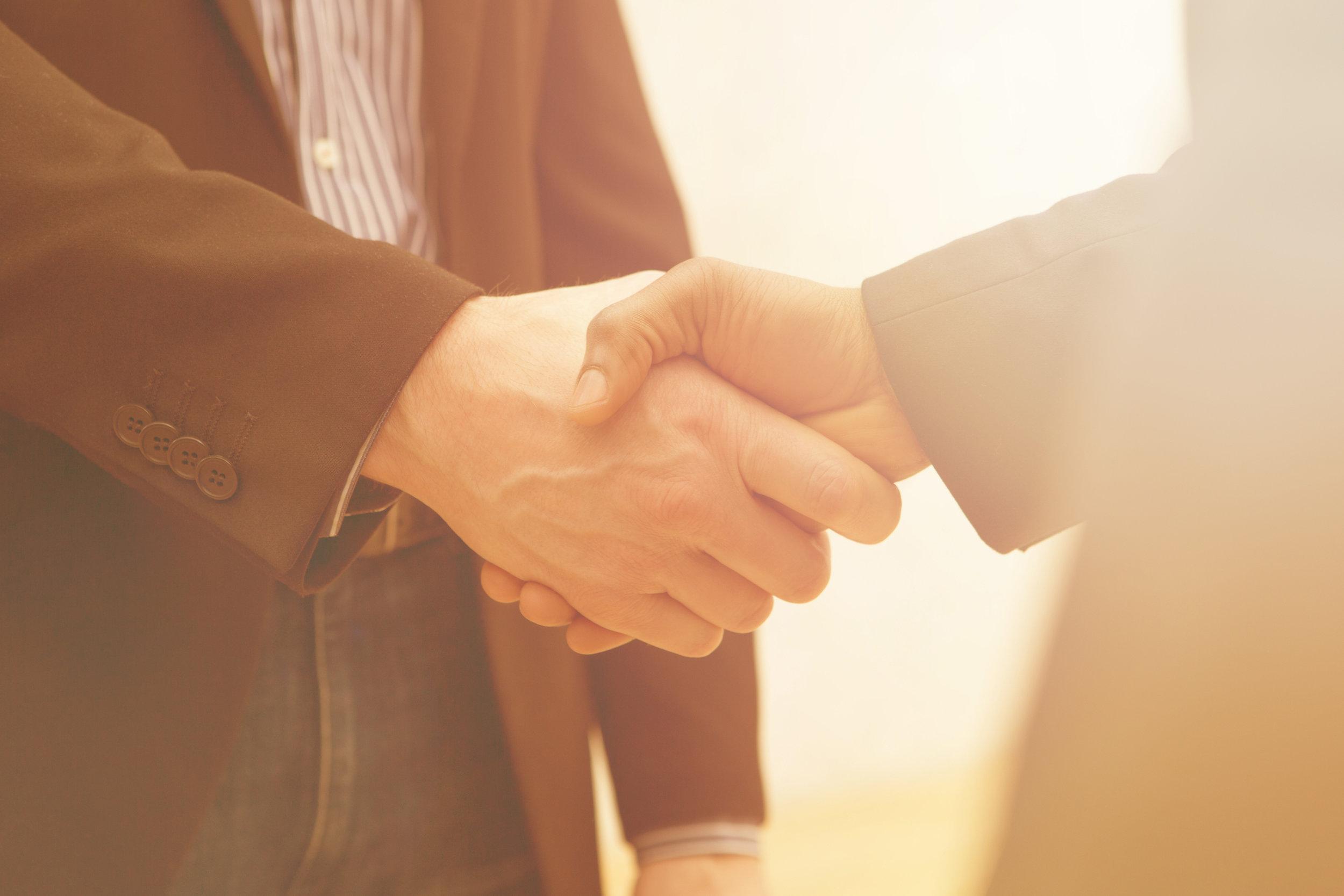 men-shaking-hands_what-is-a-security-deposit.jpg