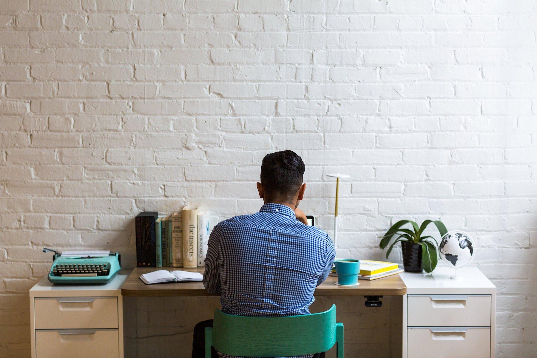 man-working-on-paperwork_new-home-checklist.jpg