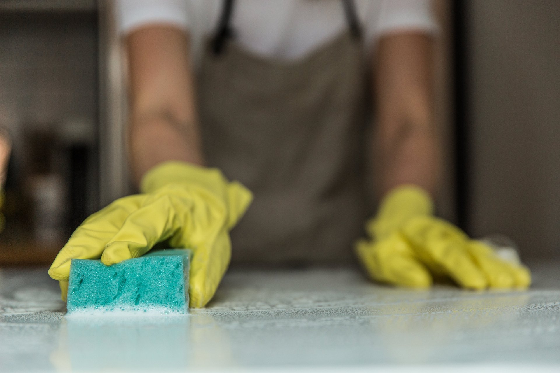 man-wiping-countertop_new-home-checklist.jpg