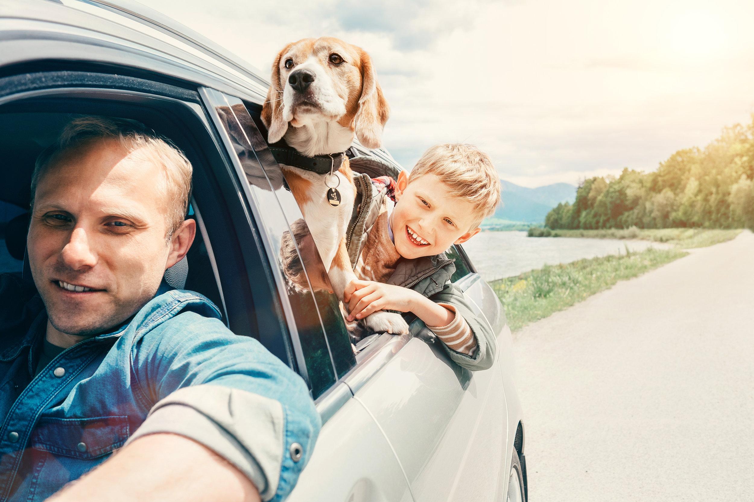 dad-son-dog-in-car_new-home-checklist.jpg