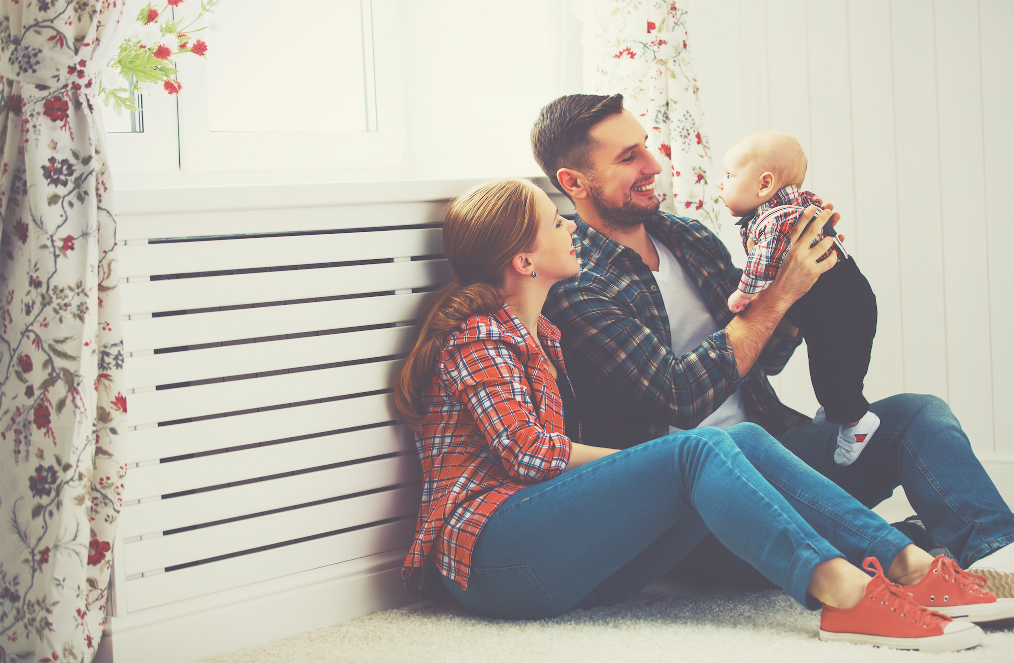 happy-mother-father-playing-baby_millennial-housing-trends.jpg