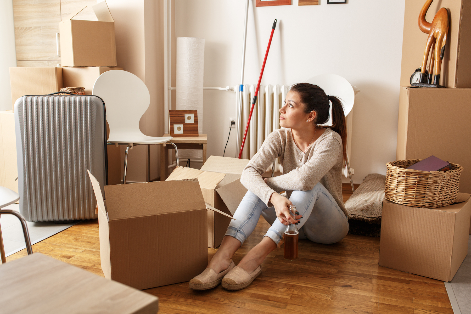 young-woman-unpacking_moving-out-for-the-first-time-checklist