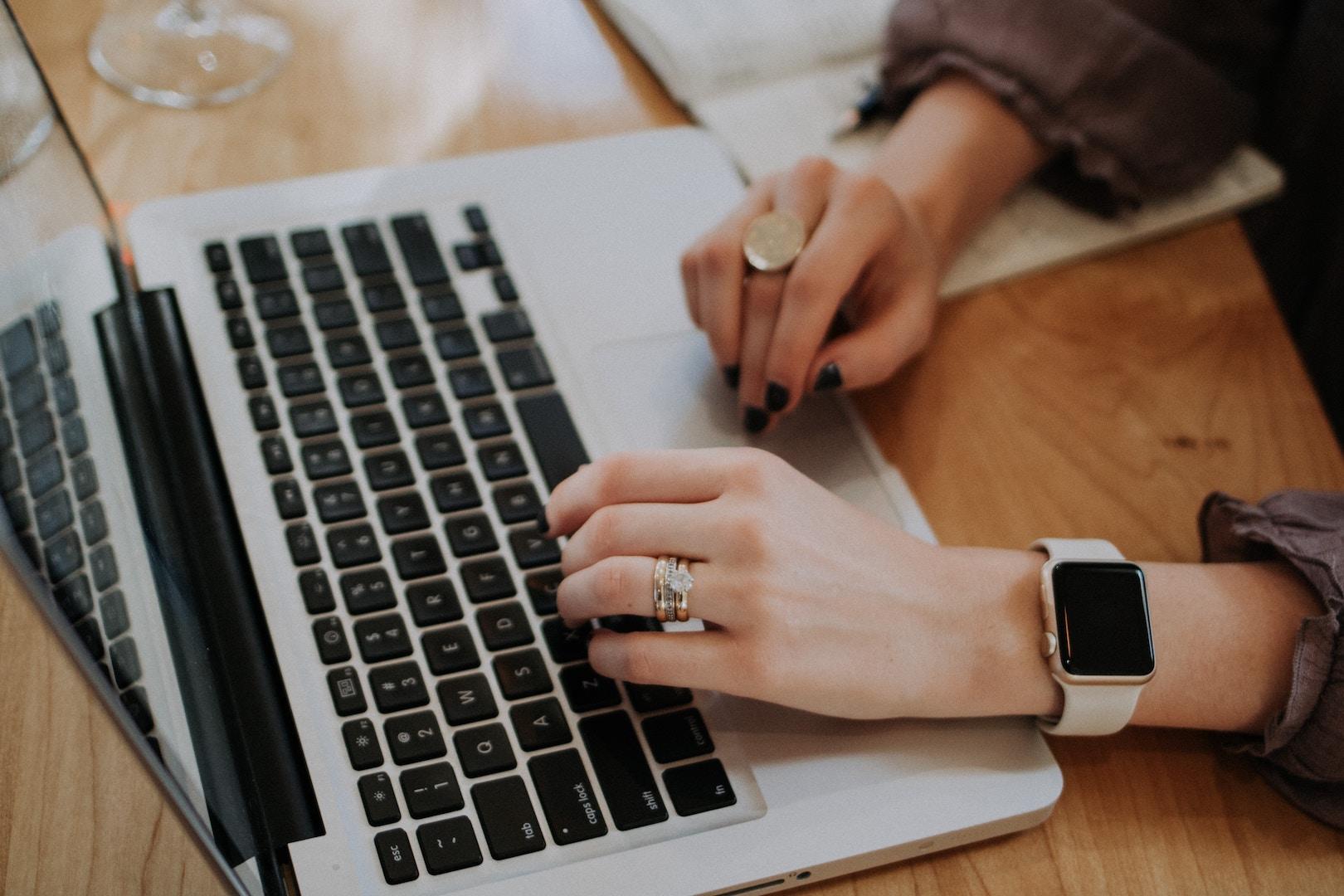 woman-typing_furniture-donation-pickup.jpg