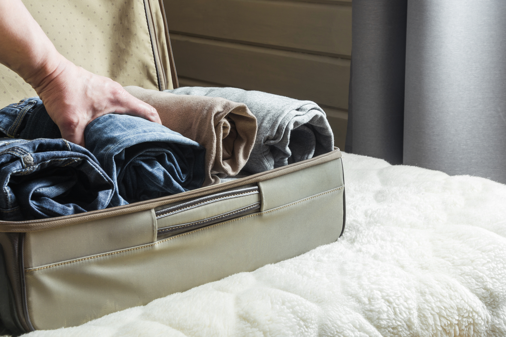 man-suitcase-how-to-pack-clothes-for-moving.jpg