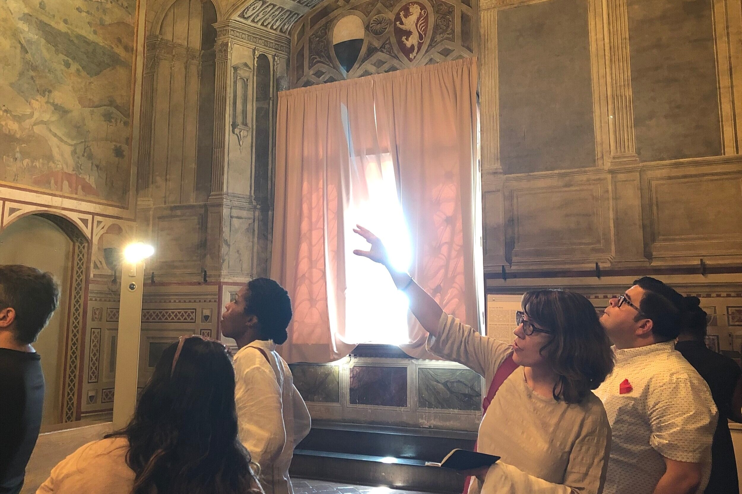 Students with Dr. Simonetta Moro with the Lorenzetti frescos. June 2019