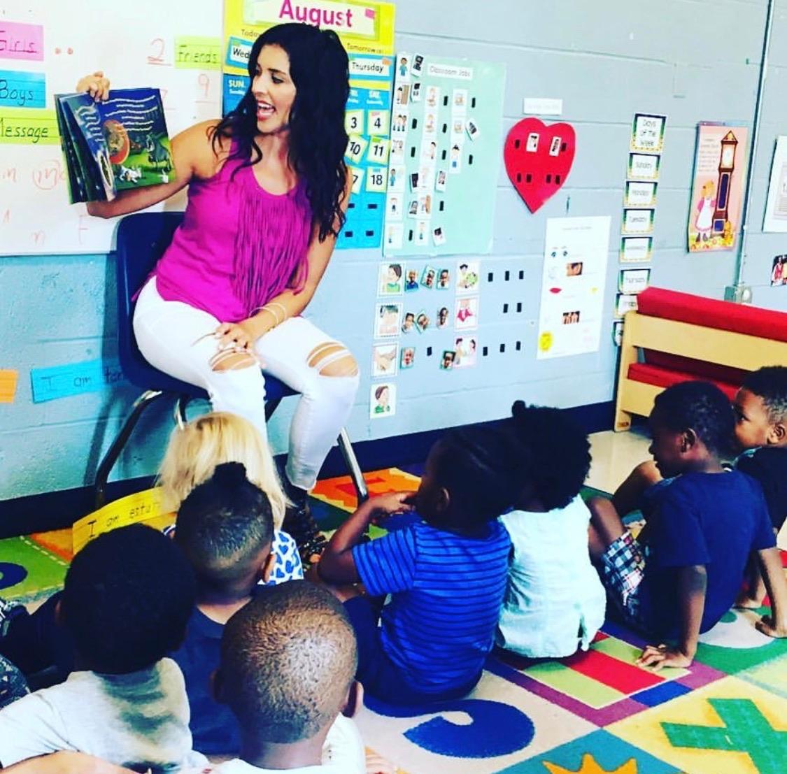 Crystal reading her children's book Mason the Bull
