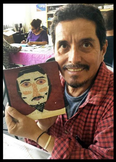 Juan with his finished journal at Visual Journalism workshop