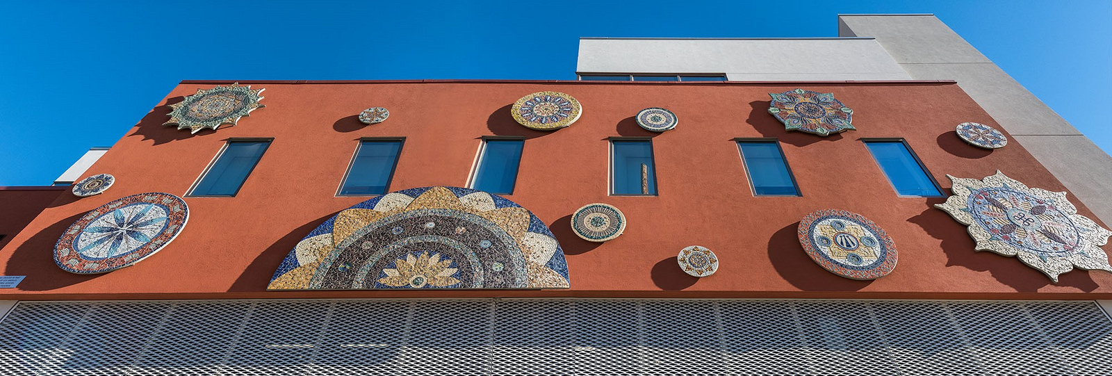 Exterior of Legal Aid Foundation of Los Angeles' new headquarters on 8th Street and Union. Piece by Piece installed a series of 13 mandalas.