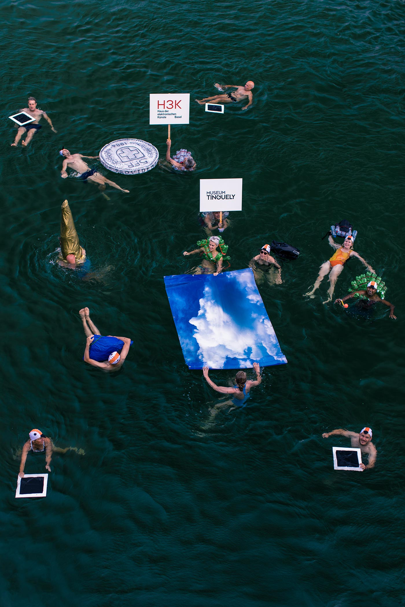 Thomas Geiger, Water Yump – A Swimming Ensemble, Project in public space, Basel July 2018, Performance & photography, C-Print, 30 × 45 cm Edition 3+2AP