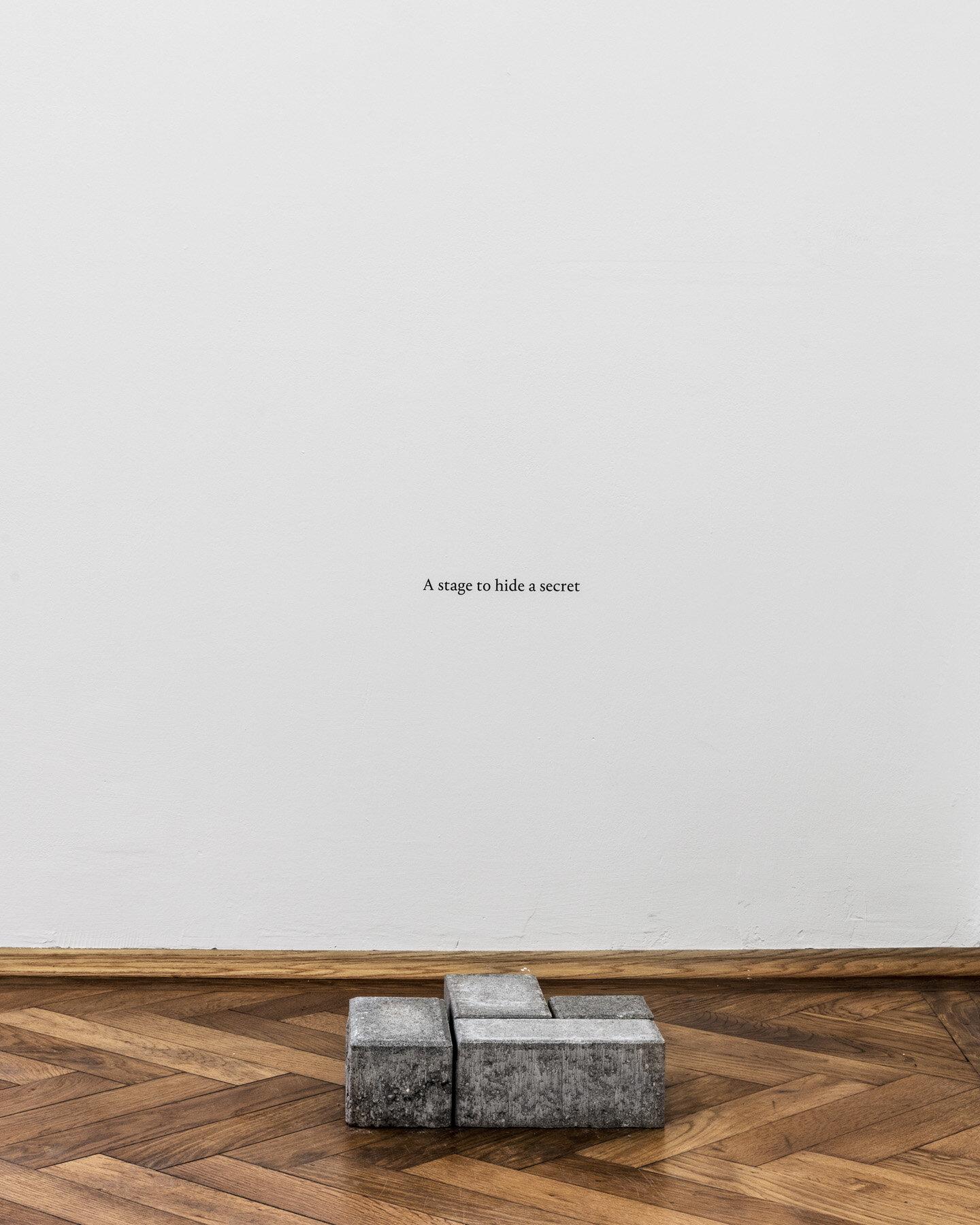 Thomas Geiger, A stage to hide a secret, 2017, concrete pavement tiles, adhesive letters, 30.5 x 30 x 8 cm