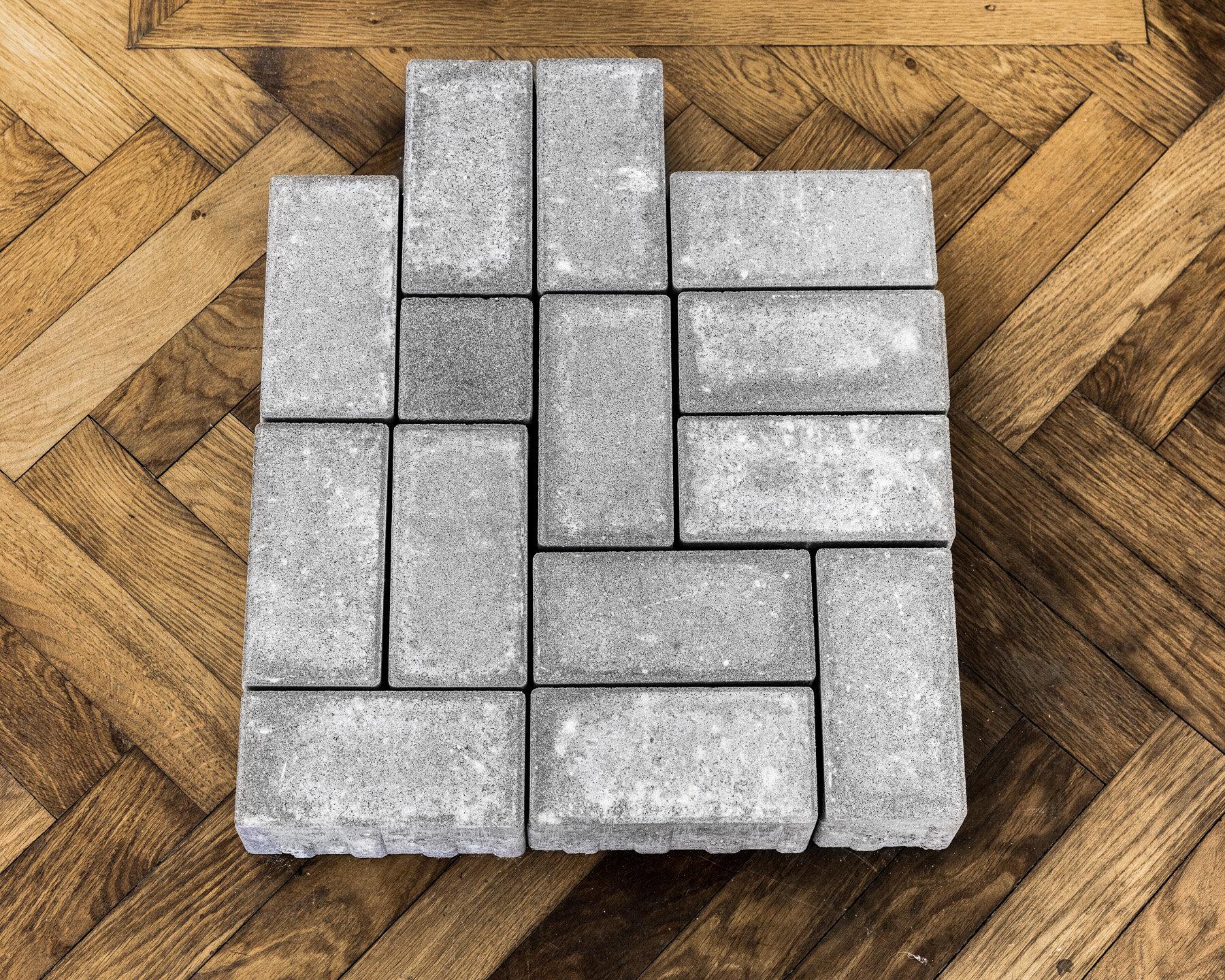 Thomas Geiger, A stage for subtle escape, 2017, concrete pavement tiles, adhesive letters, 60 x 50 x 8 cm