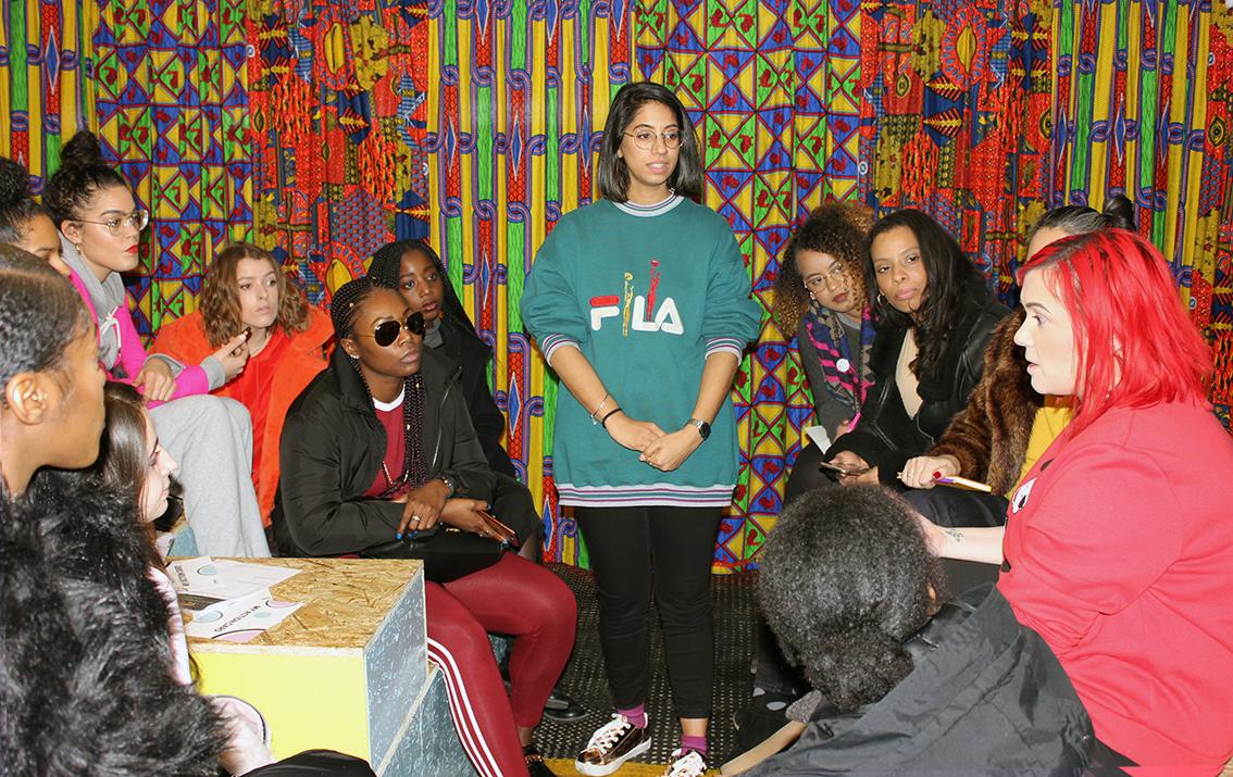 Panelist Roshni speaking with attendees