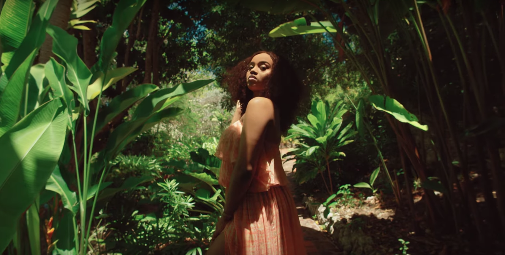 Chioma looking sultry in the Bajan jungle for her boyfriend Davido's latest music video, Assurance.