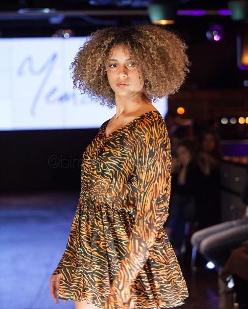 A model wears Yemzi SS18 silk chiffon dress at CMM fashion extravaganza, a busines Cherisea founded in November 2015