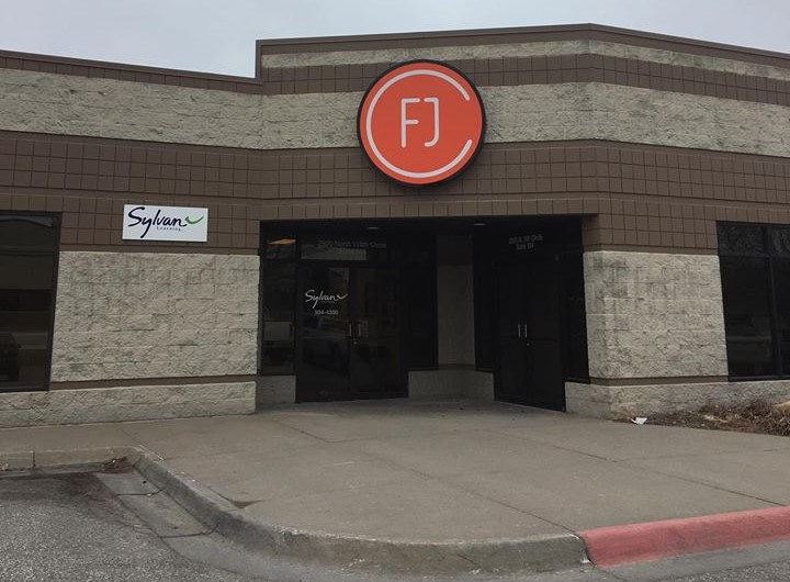 The entrance to Faith Journey Church is East of FJC logo sign.
