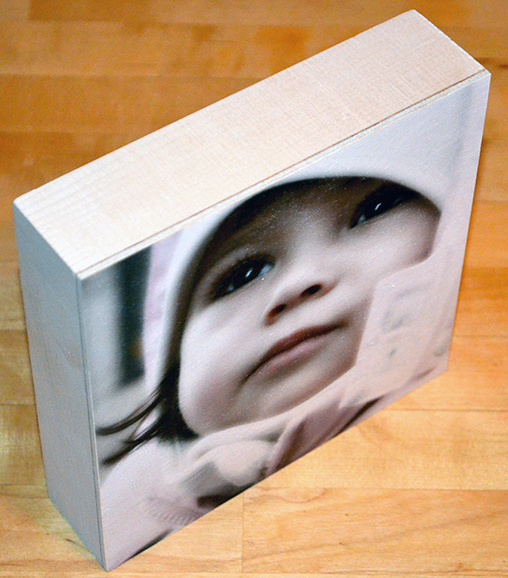 Family photo on wood box panel
