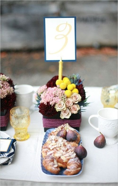 Colored glass, figs, floral bunches (invitesweddings.com)