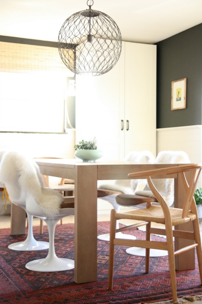 If you're tired of your current dining chairs, but don't want to splurge on replacing the entire set, replace the two that sit at either end for a polished and eclectic vibe. Via  House Tweaking