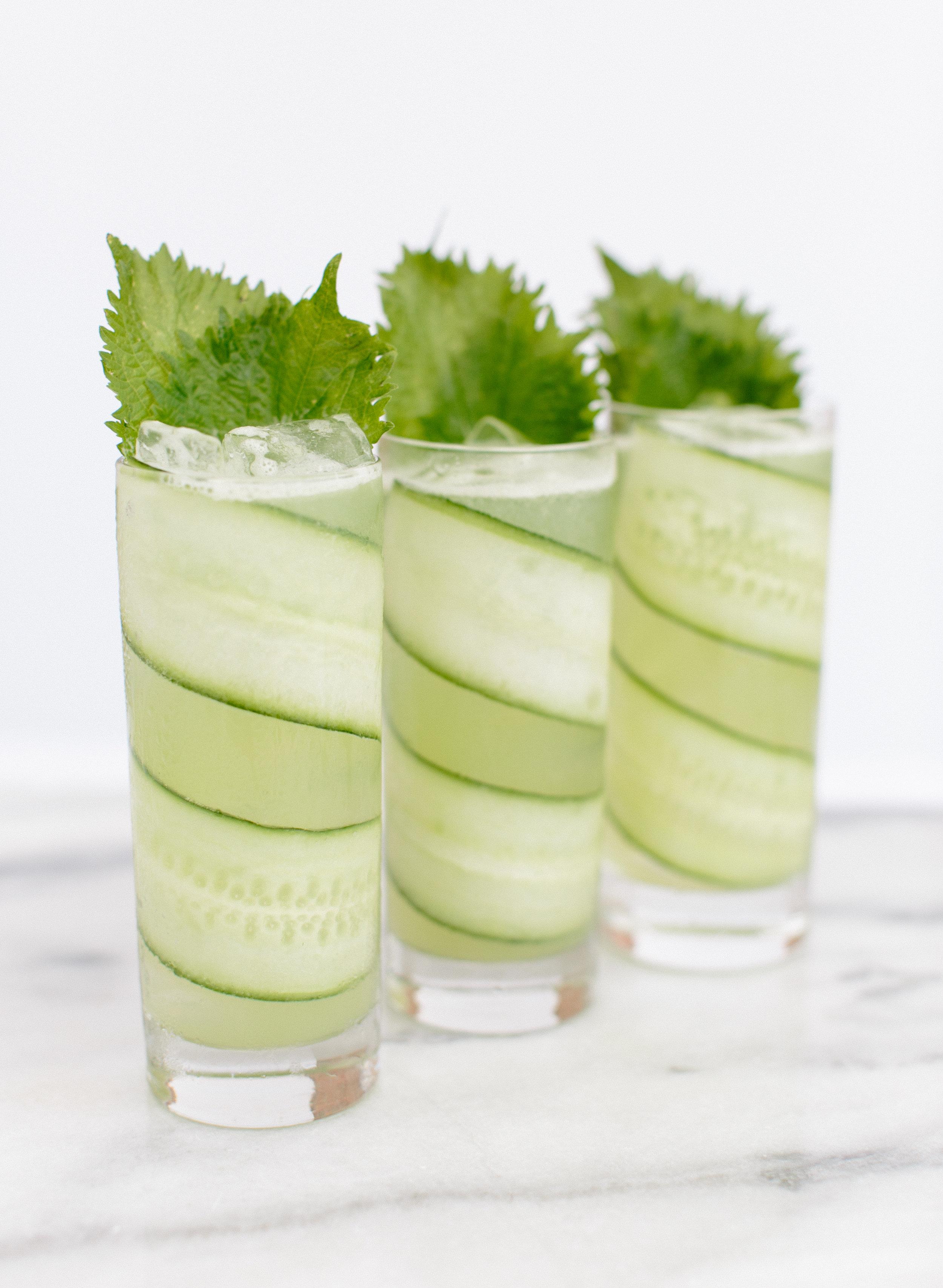 The Green Whisper - Glass – highballMethod – shake and strainGarnish – long thin cucumber spiral; 2 shiso leaves2 oz. vodka or gin1.25 oz. fresh English cucumber juice.75 oz. fresh lime juice.75 oz. house-made green peppercorn syrup