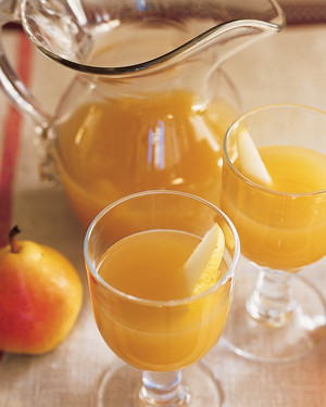 Pear and Sparkling Cider - An earthy, sweet pear-cider cocktail is tinged with whiskey -- a perfect drink for a cold day.