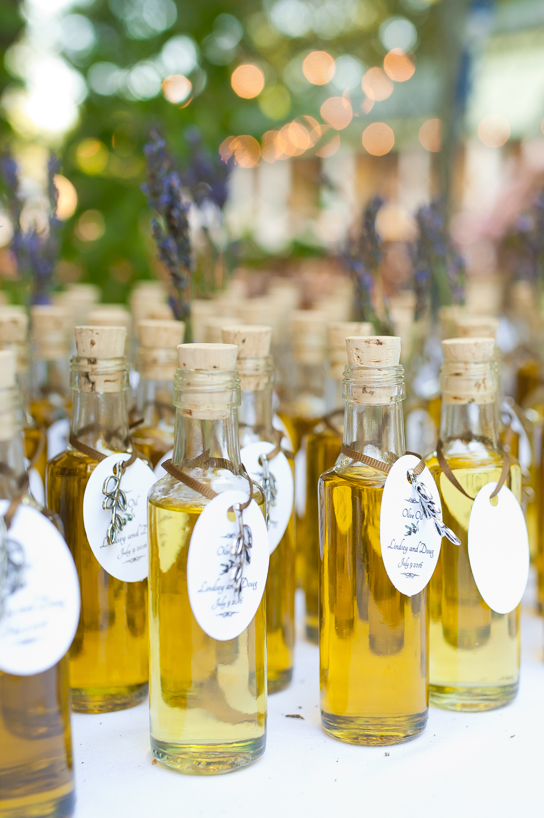 Mini Olive Oil Bottle - While this isn't a typical wedding favor, mini bottles of olive oil look amazing on the table and are definitely memorable! Olive oils and balsamic vinegars are an elegant choice, especially for a Napa Valley vineyard wedding! Better yet, you know your guests will use this in their kitchen and think of your special day every time they do!Photographer: c.m.elle studios
