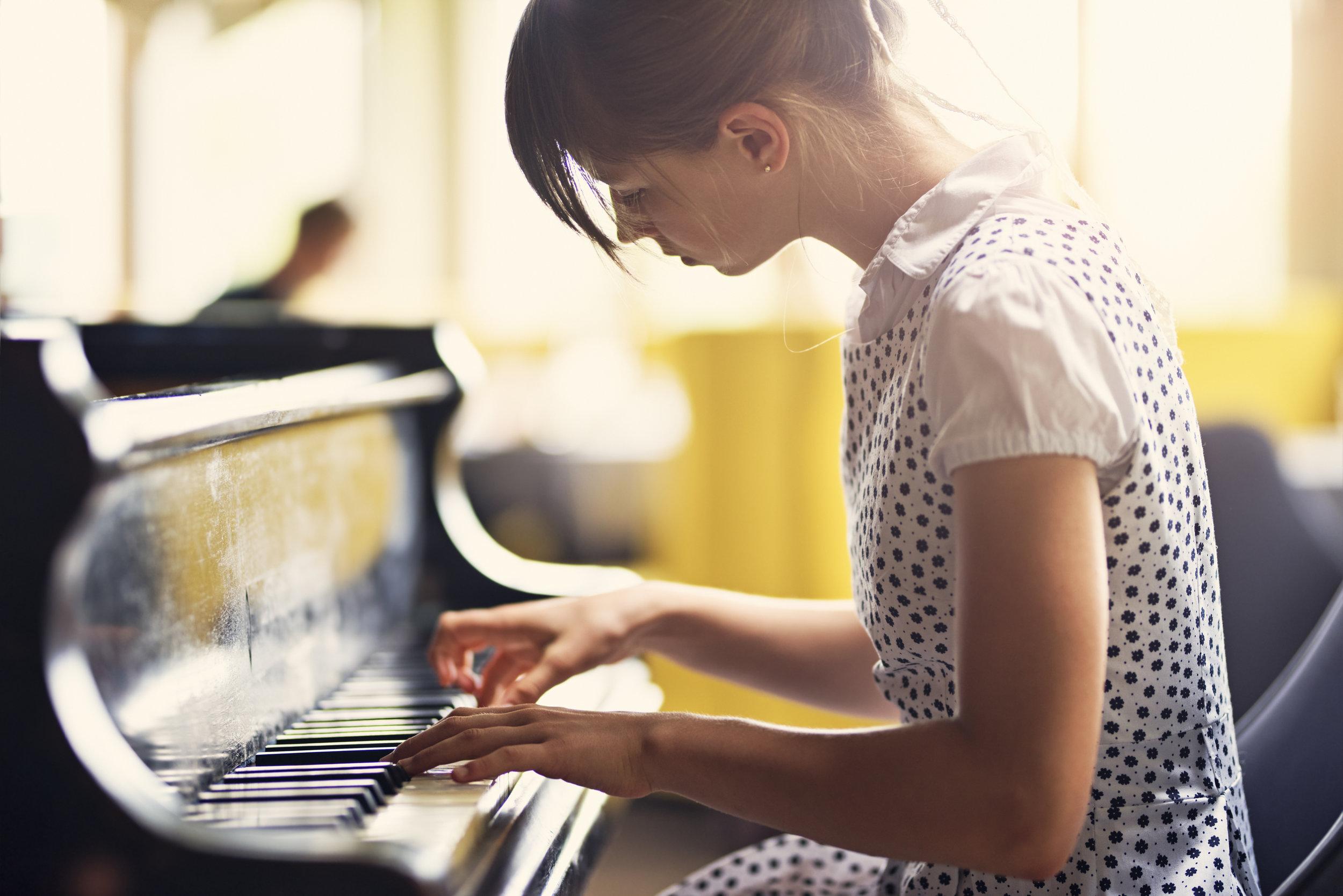 cms stock photo girl playing piano.jpg