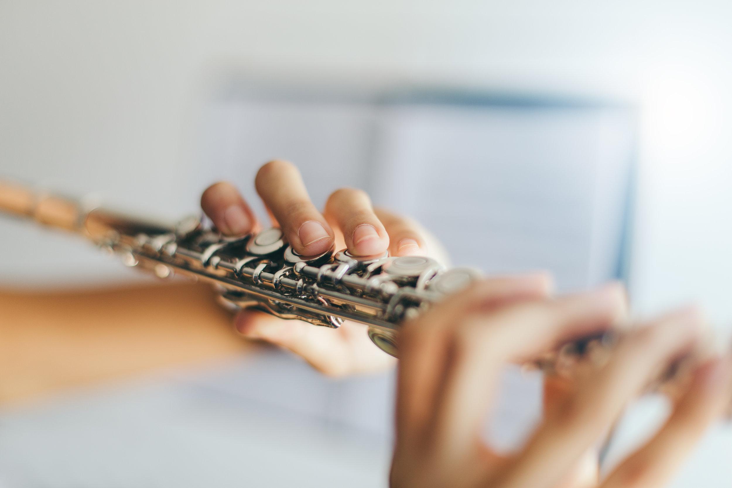 cms stock photo hands on flute.jpg